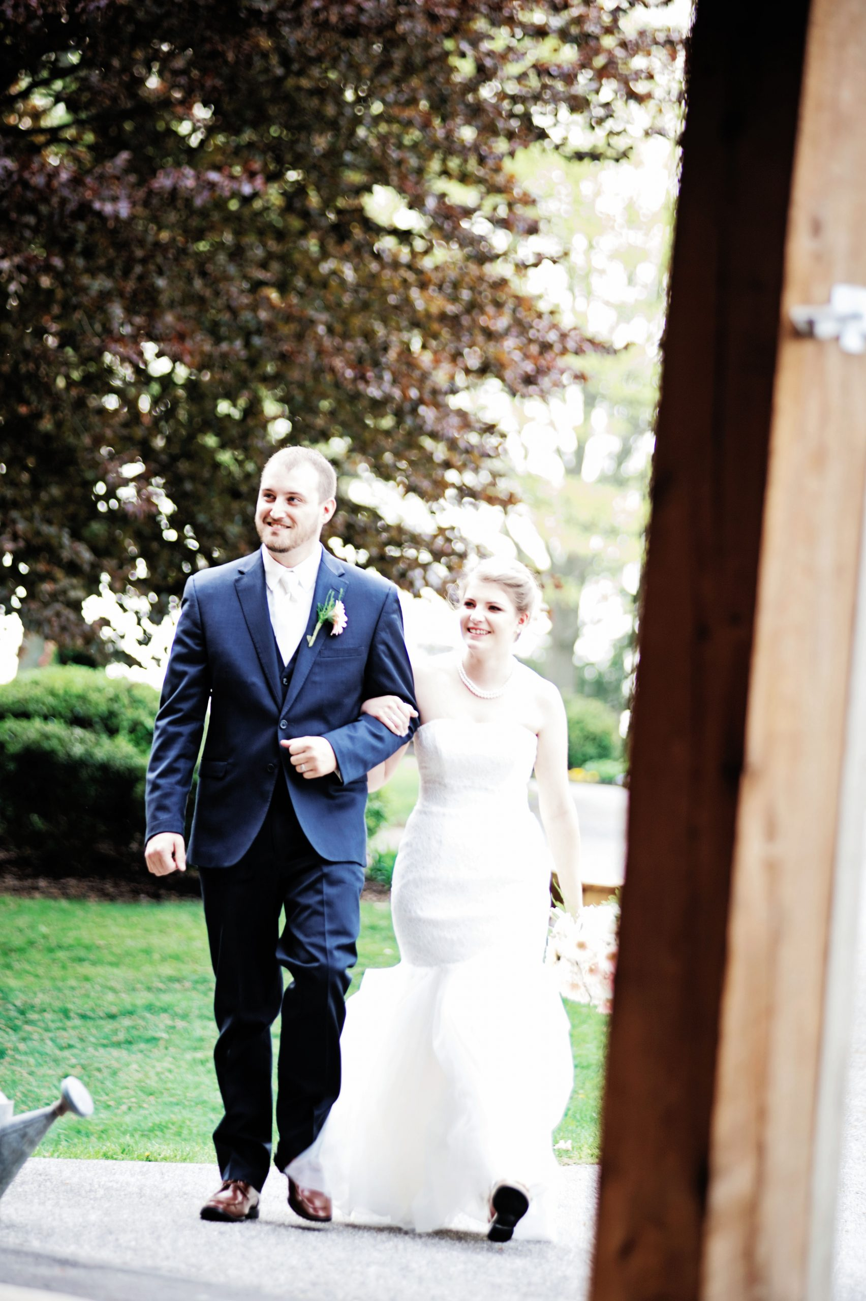 the newlyweds walk into their reception in the rustic barn at Lakeview Farms of York, PA. Lovefusion caught this iconic moment for the couple to remember forever. Featured on Dream Weddings.
