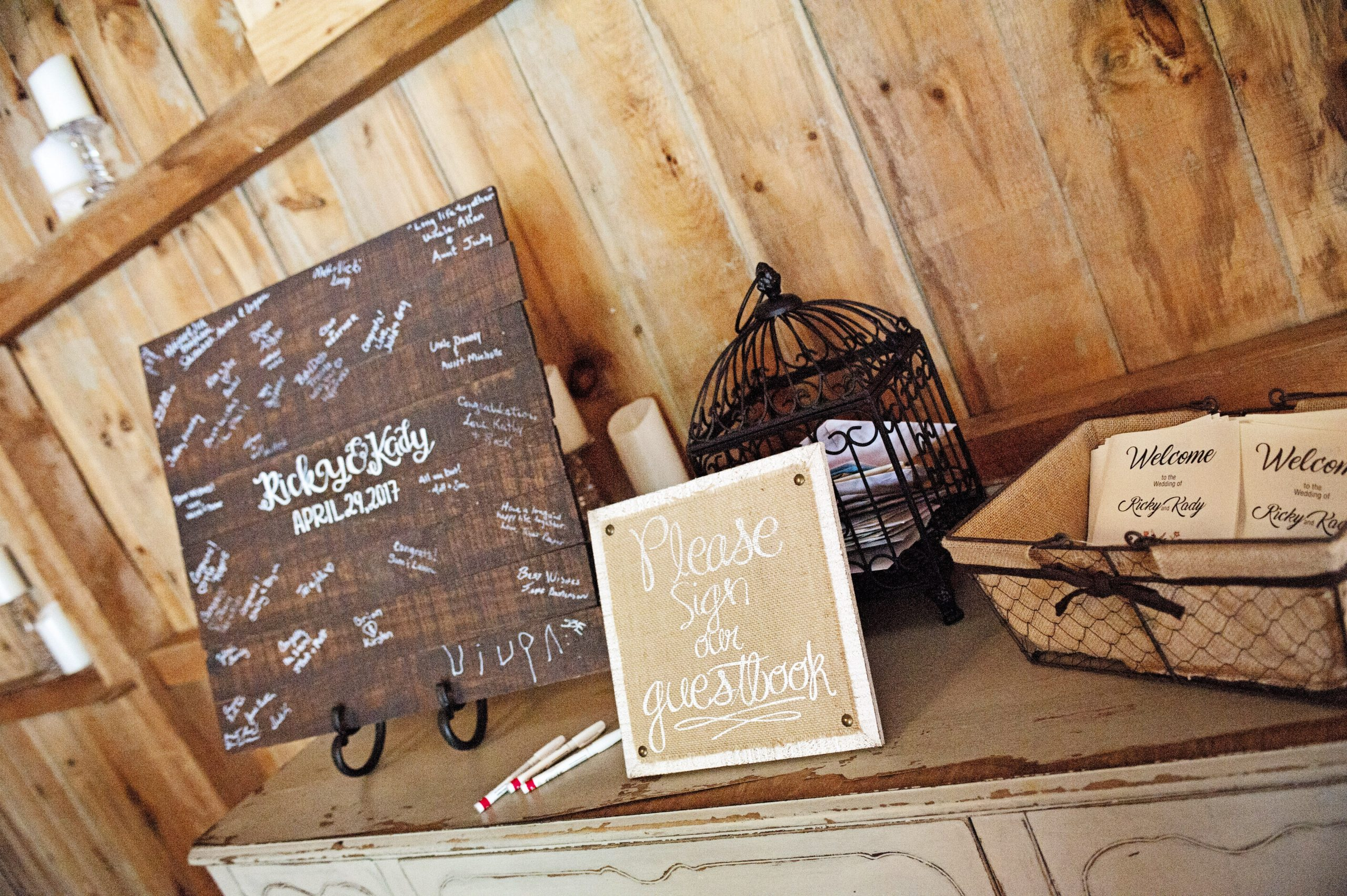As guests walk in, they sign the guestbook entering the barns of Lakeview Farms in York, PA. Capturing this is Lovefusion Photography. Lakeview Farms of York, PA offers couples a chance to bring it down a notch and really wnjoy the company you have. Lovefusion beautifully displays that with this picture of the simple, yet elegant reception hall. Featured on Dream Weddings.