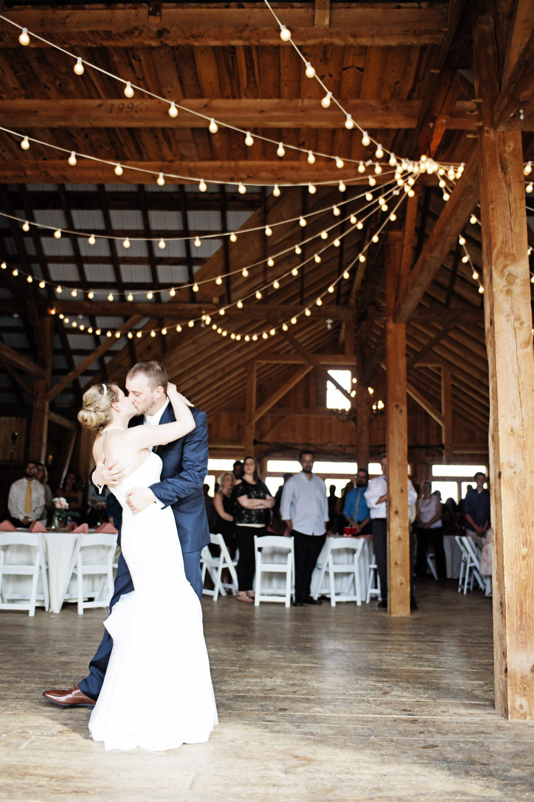 With barn beams of Lakeview Farms framing the couple, Lovefusion Photography takes this chance to capture the perfect moment.Featured on Dream Weddings.