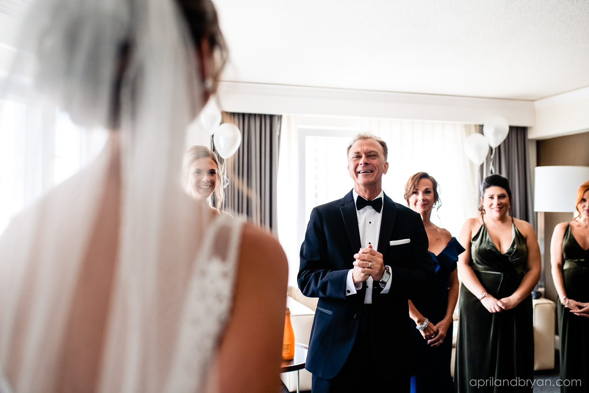 Father of the bride sees his daughter for the first time at the franklin Institute in Philadelphia. Shot by April & Bryan Photography. Featured on Dream Weddings.