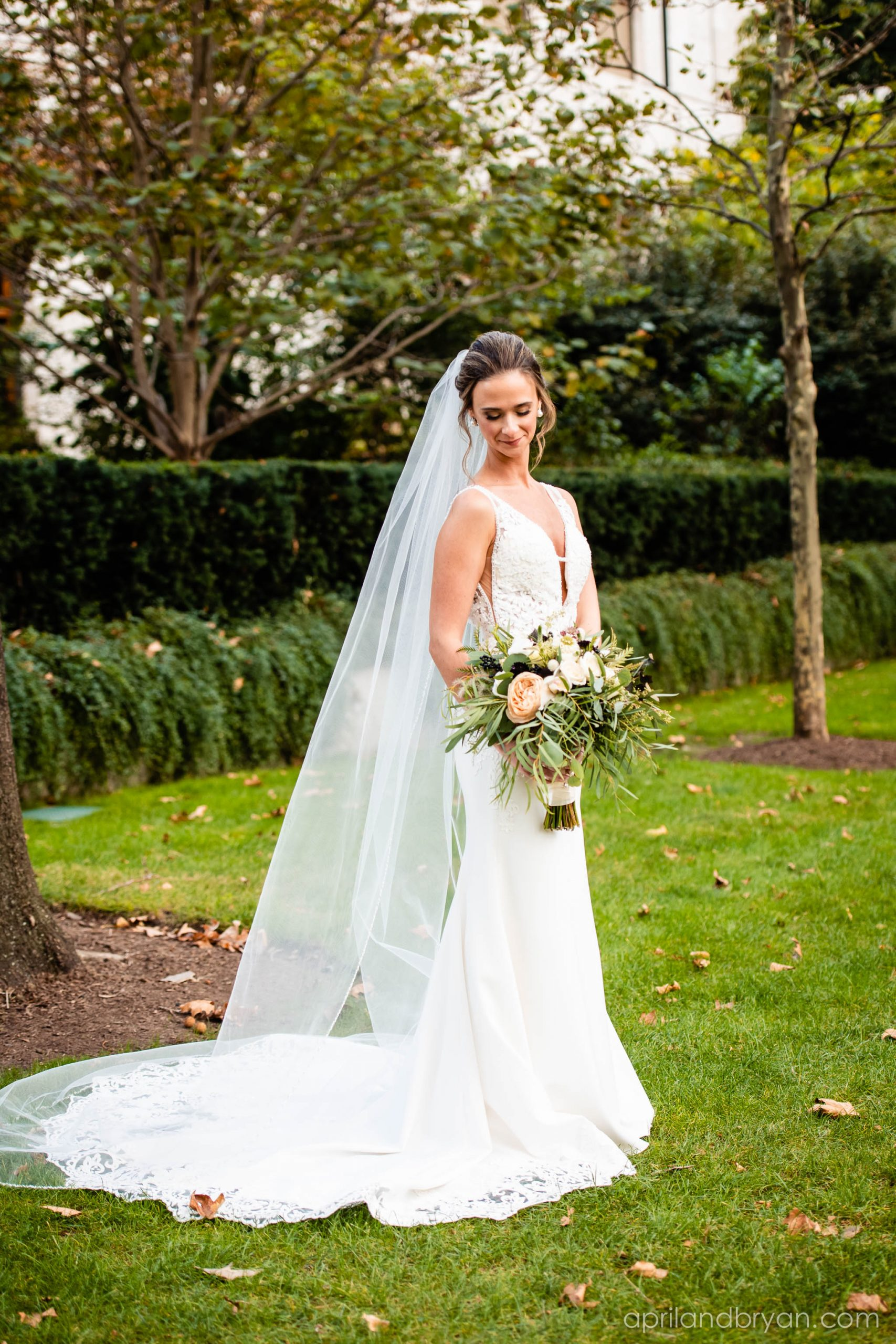 A blushing bride in the gardens of the Franklin Institute in Philadelphia. Shot by none other than April & Bryan Photography. Featured on Dream Weddings.