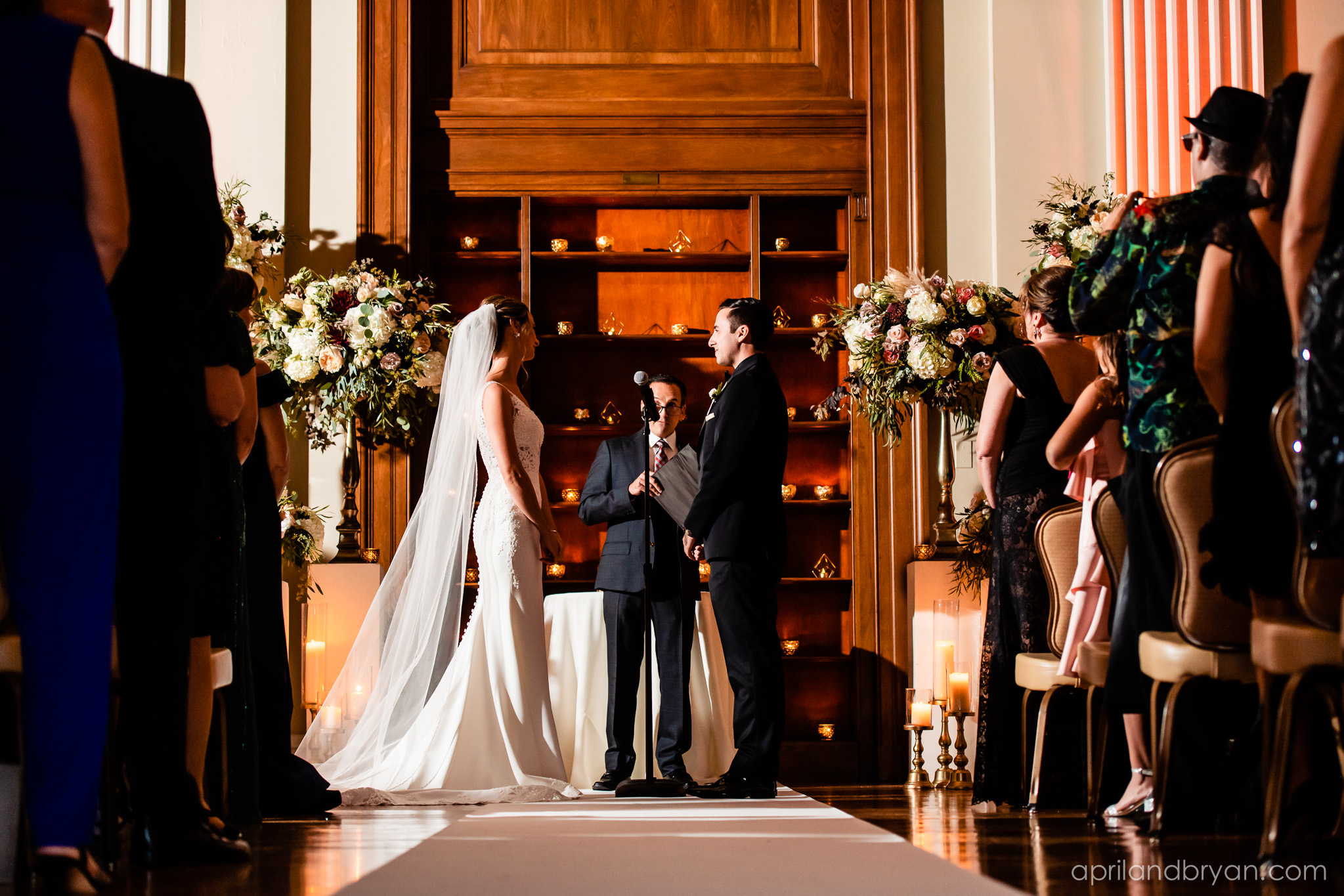 The ceremony begins and is beautifully captured by April & Bryan Photography. Featured on Dream Weddings.