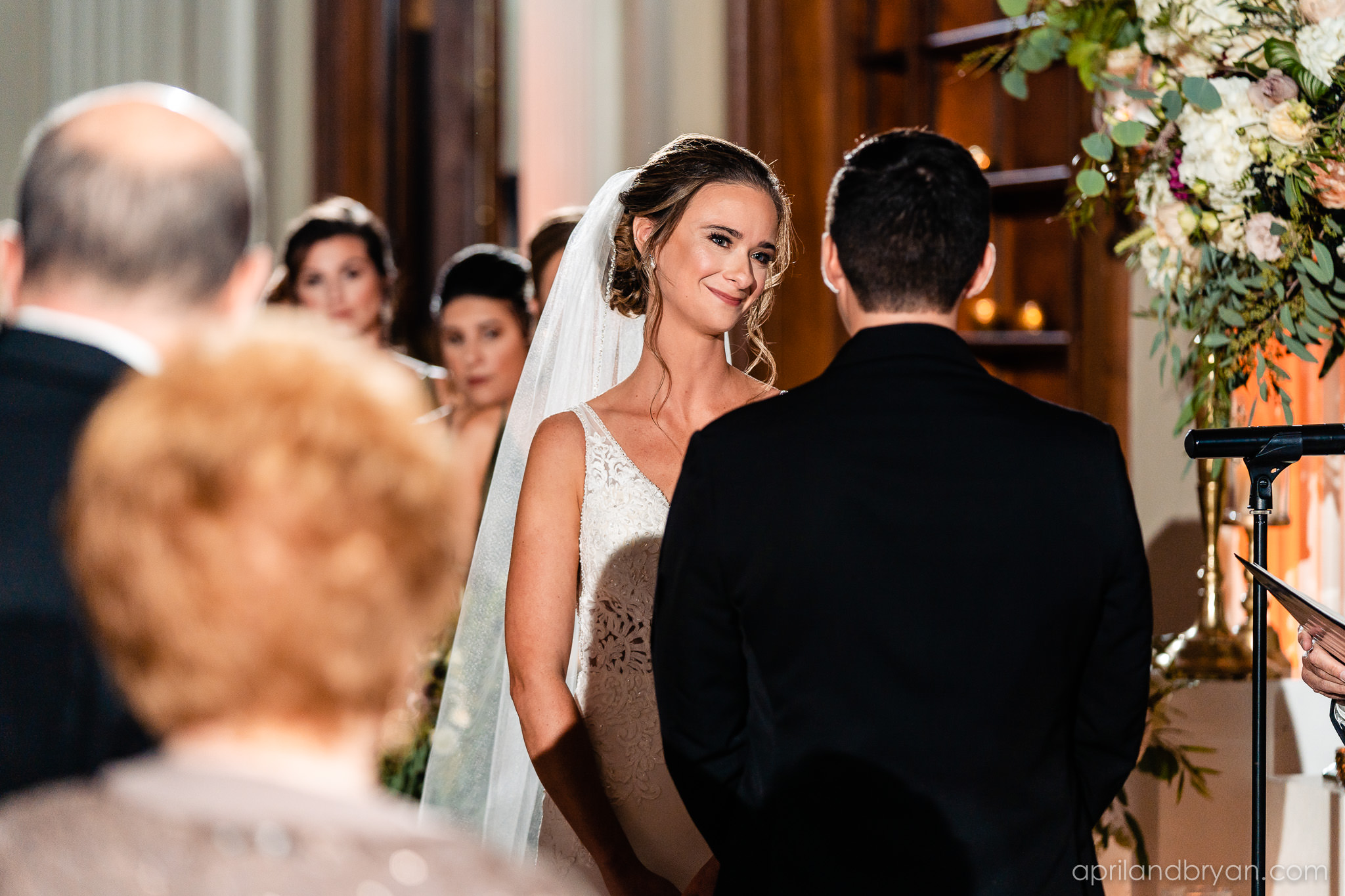 A lover's gaze captured by April & Bryan Photography. Featured on Dream Weddings.