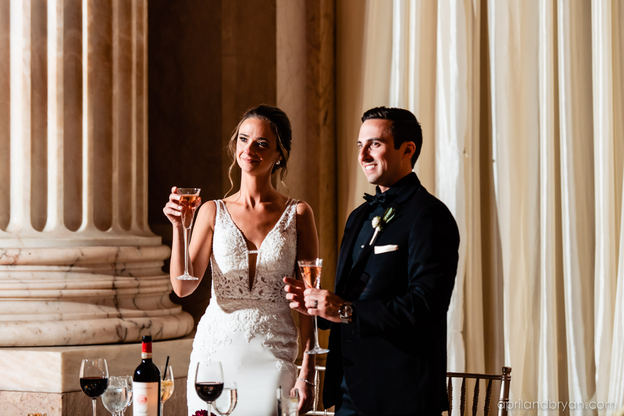 A toast at the franklin Institute in Philadelphia sets the tone for a beautiful moment captured by April & Bryan Photography. Featured on Dream Weddings.