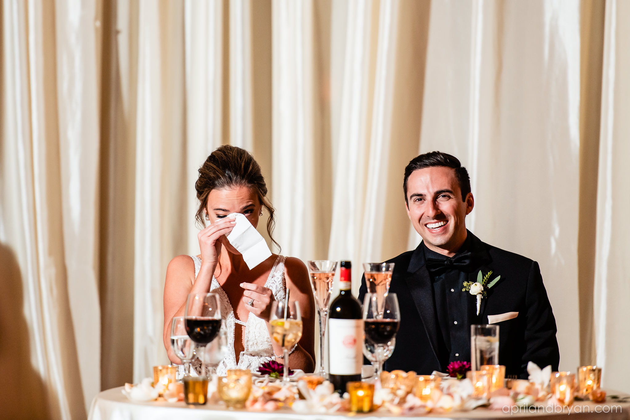 Speeches have the bride in tears at the Franklin Institute in Philadelphia. All tears and smiles captured by April & Bryan Photography. Featured on Dream Weddings.