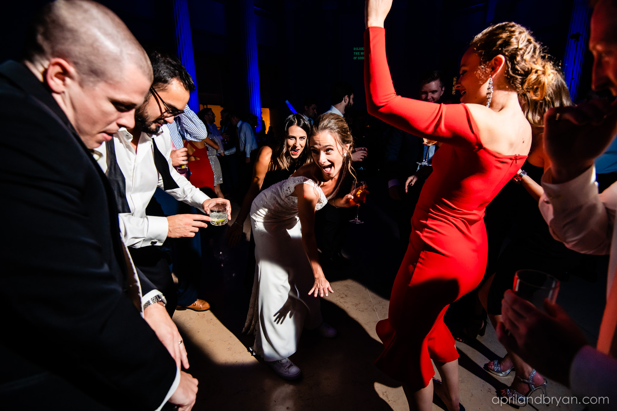 The bride gets a little risky with her moves on the dance floor at the franklin Institute. Captured by April & Bryan Photography. Featured on dream Weddings.