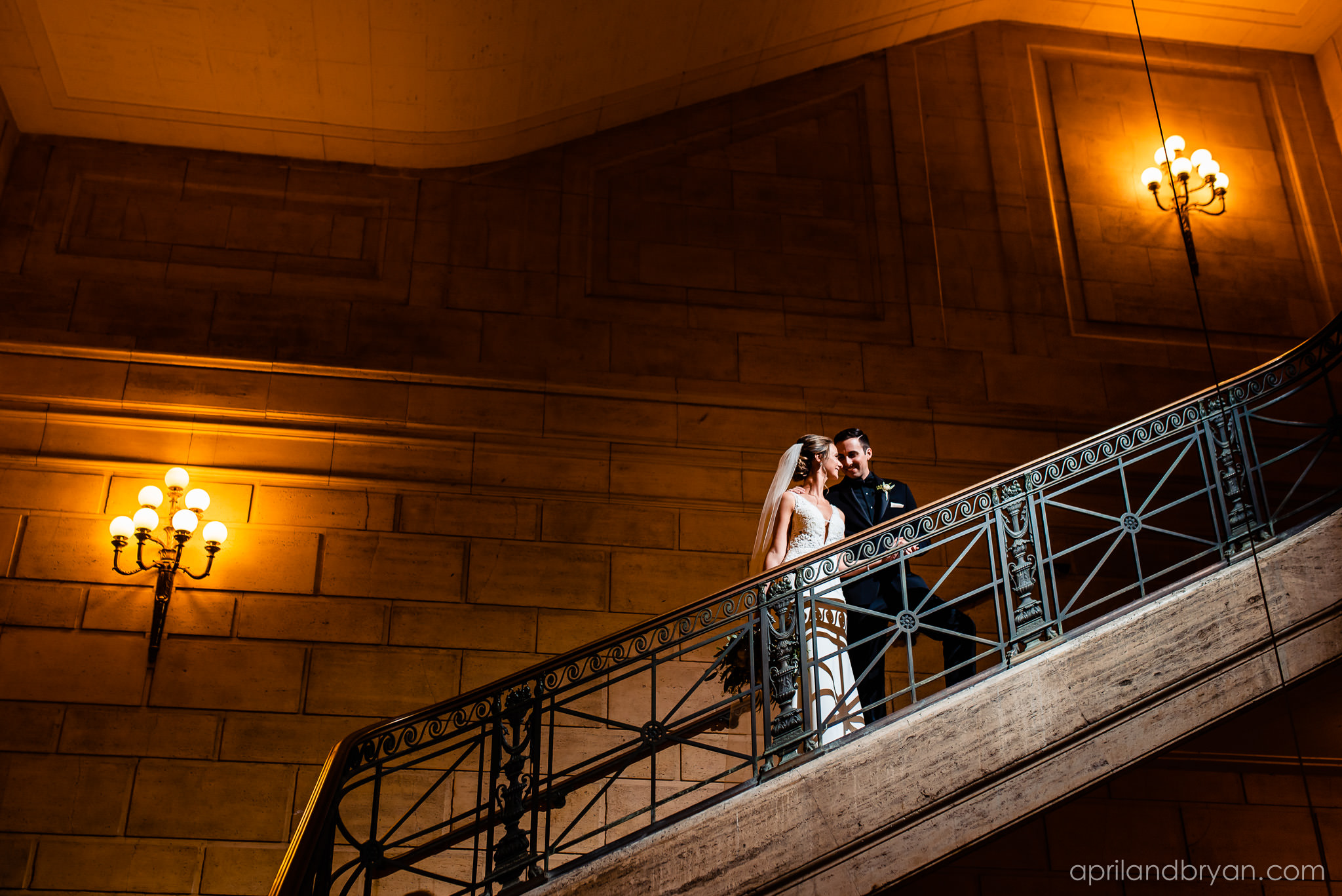 The steps of the Franklin Institute in Philadelphia, PA serves as a perfect photo opportunity shot by April & Bryan Photography. Featured on Dream Weddings.