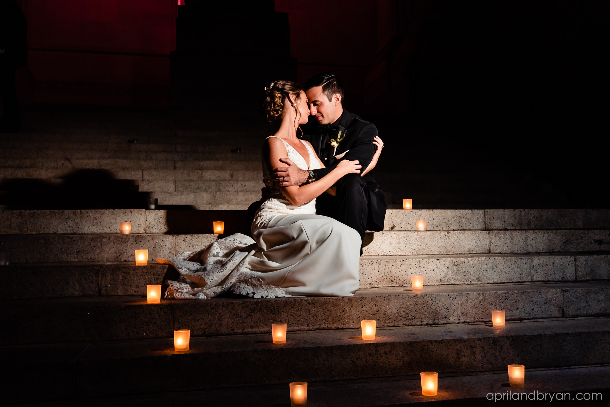 The last warm embrace before bride and groom are off to their honeymoon after The Franklin Institute held their Dream Wedding, captured by April & Bryan Photography.