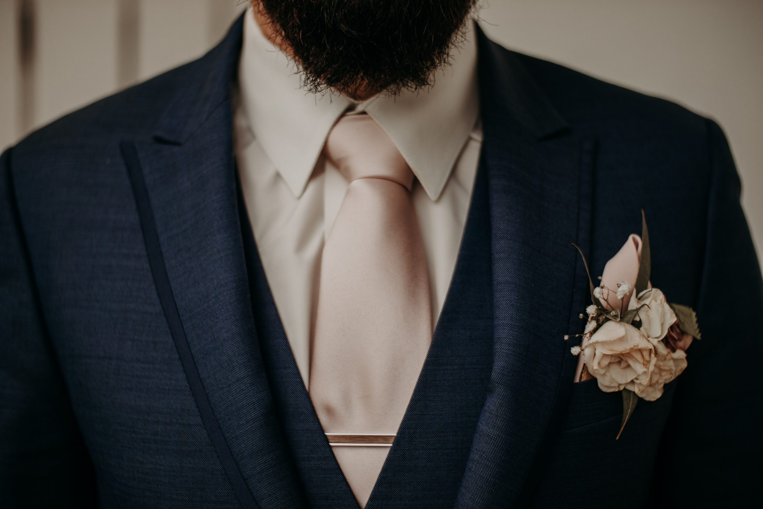 The groom is ready to marry the love of his life. In pastel pink and a navy blue suite, he is fitted and prepared to say i DO. Christine and Richard wed on the Chestnut Hill Villa grounds on May of 2019. This organic ethereal styled wedding was captured by Garnet Dahlia Photography and featured on Dream Weddings.
