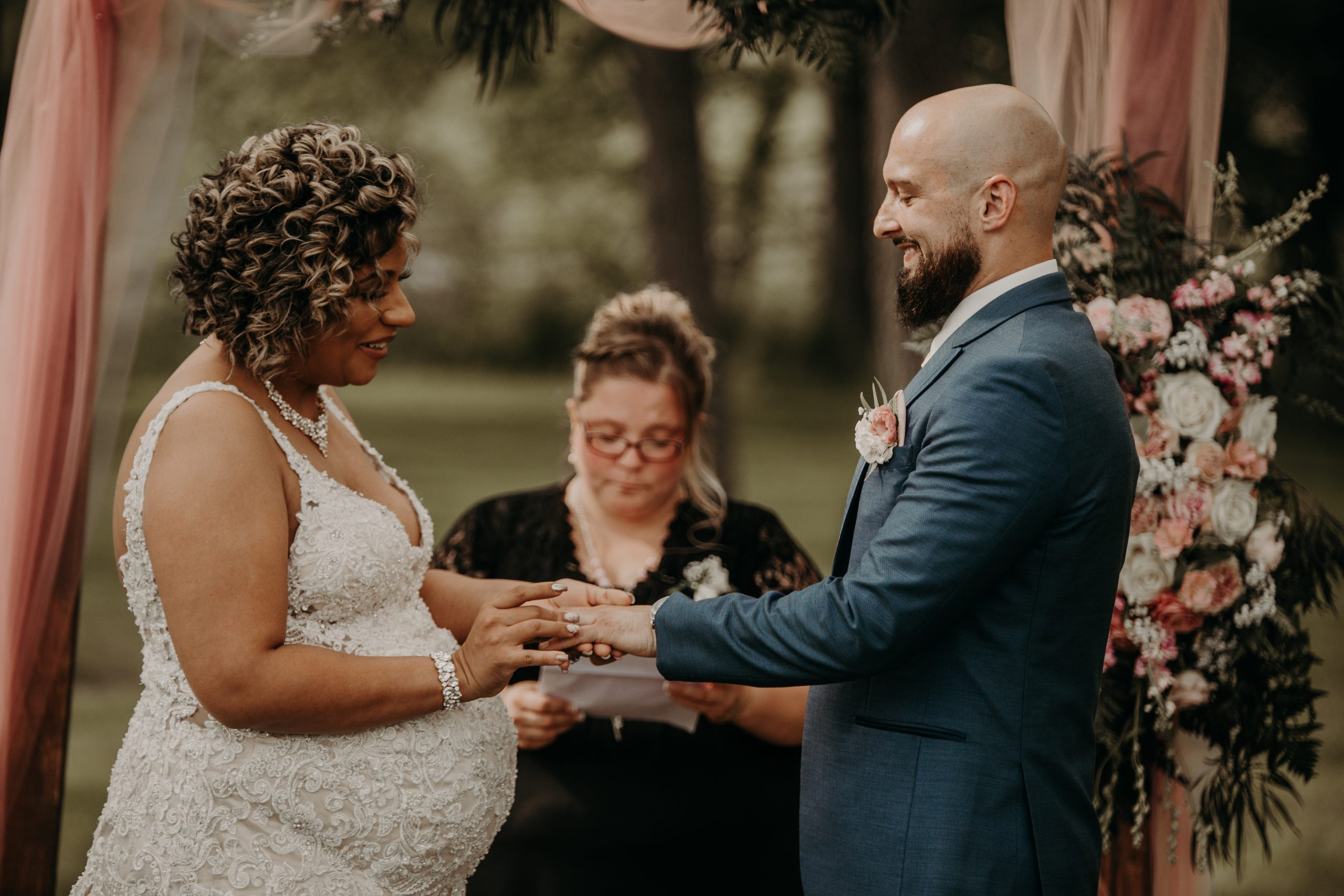 the exchange of wedding rings makes it official. Christine and Richard wed on the Chestnut Hill Villa grounds on May of 2019. This organic ethereal styled wedding was captured by Garnet Dahlia Photography and featured on Dream Weddings.