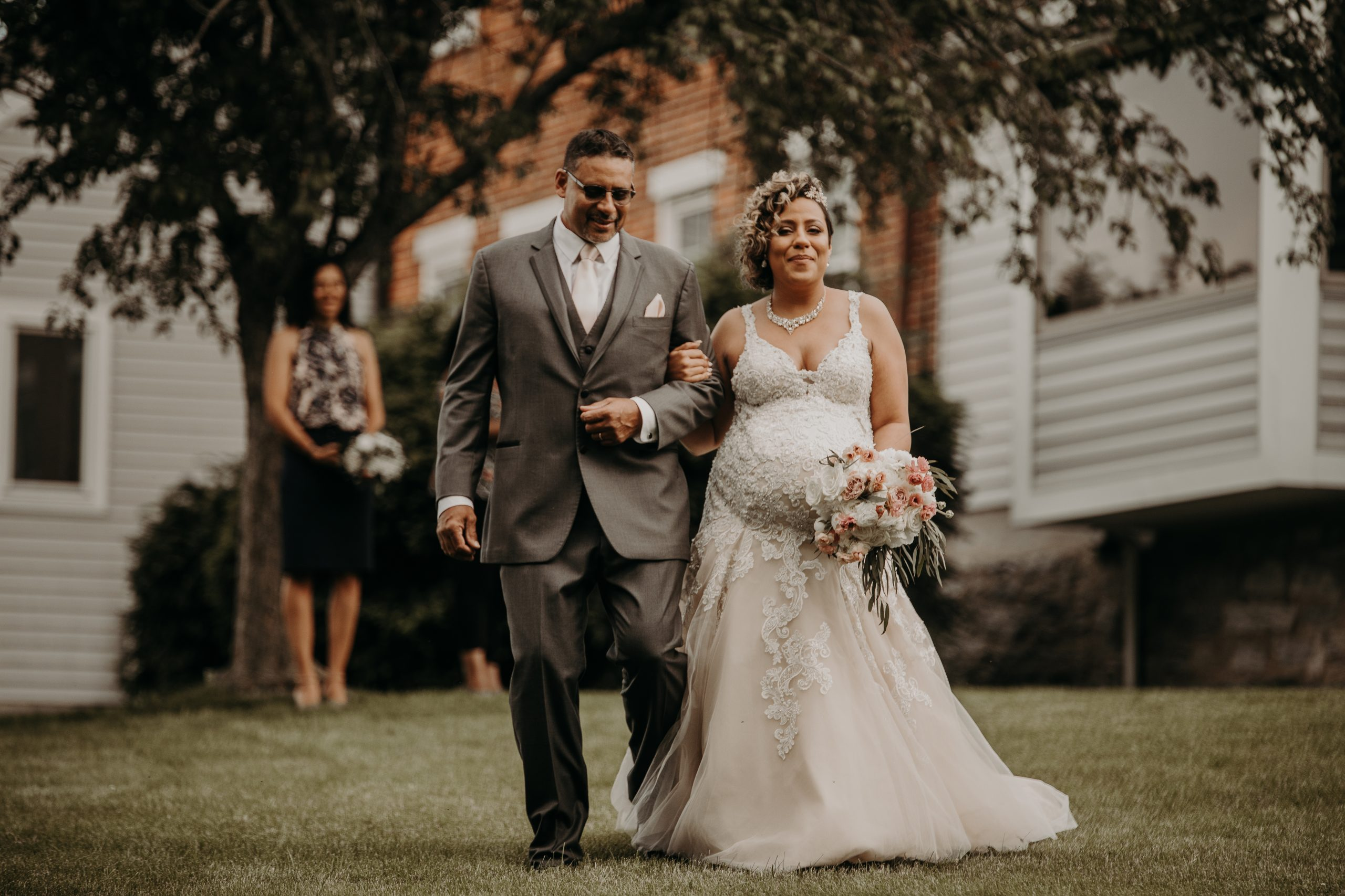 Christine and her father prepare to make their way down the isle, where they will meet Richard at the end. He will give his daughter away. Christine and Richard wed on the Chestnut Hill Villa grounds on May of 2019. This organic ethereal styled wedding was captured by Garnet Dahlia Photography and featured on Dream Weddings.