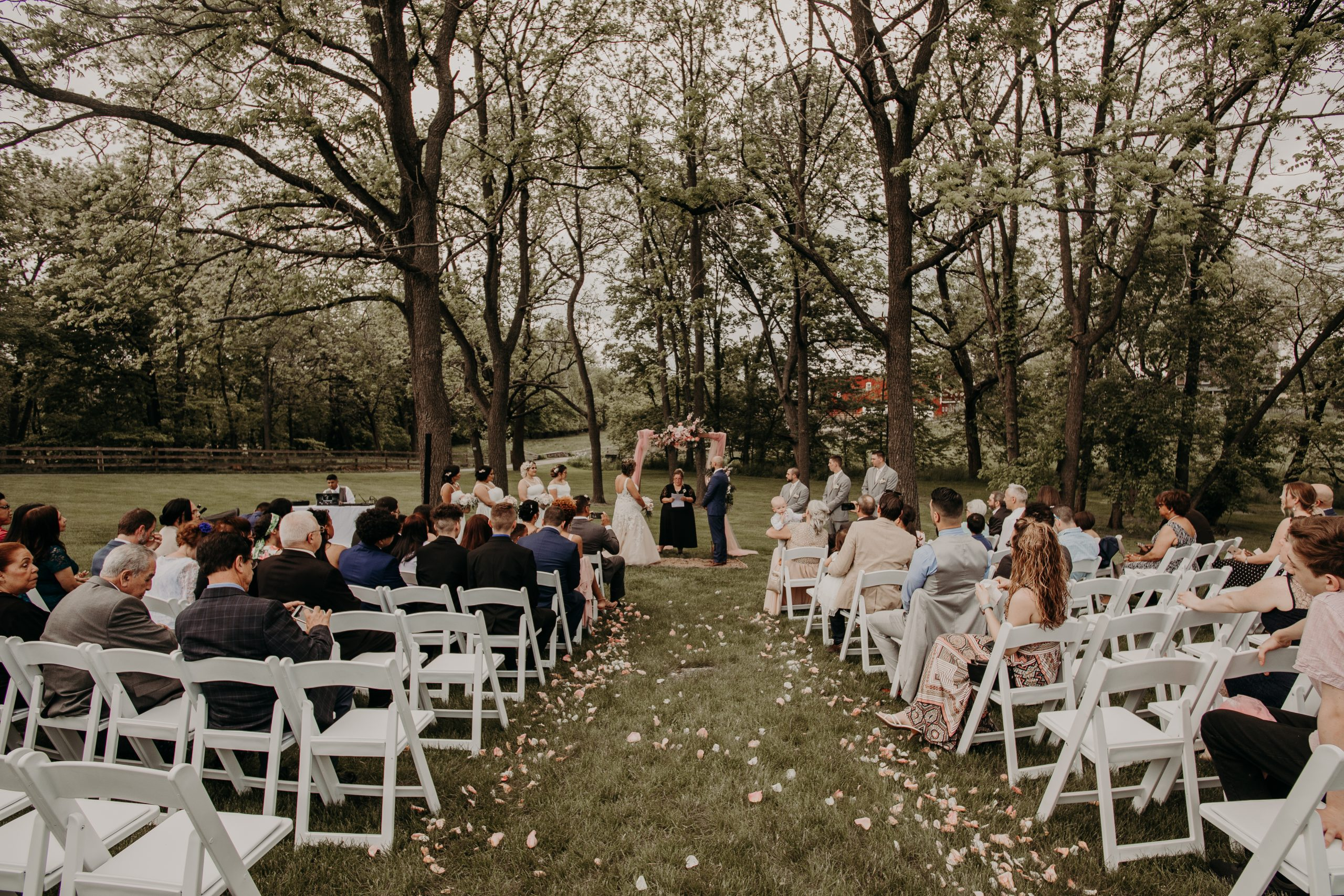 A perfect day for a wedding ceremony outside. full of green and the clean lines of white add an amazing contrast. Christine and Richard wed on the Chestnut Hill Villa grounds on May of 2019. This organic ethereal styled wedding was captured by Garnet Dahlia Photography and featured on Dream Weddings.