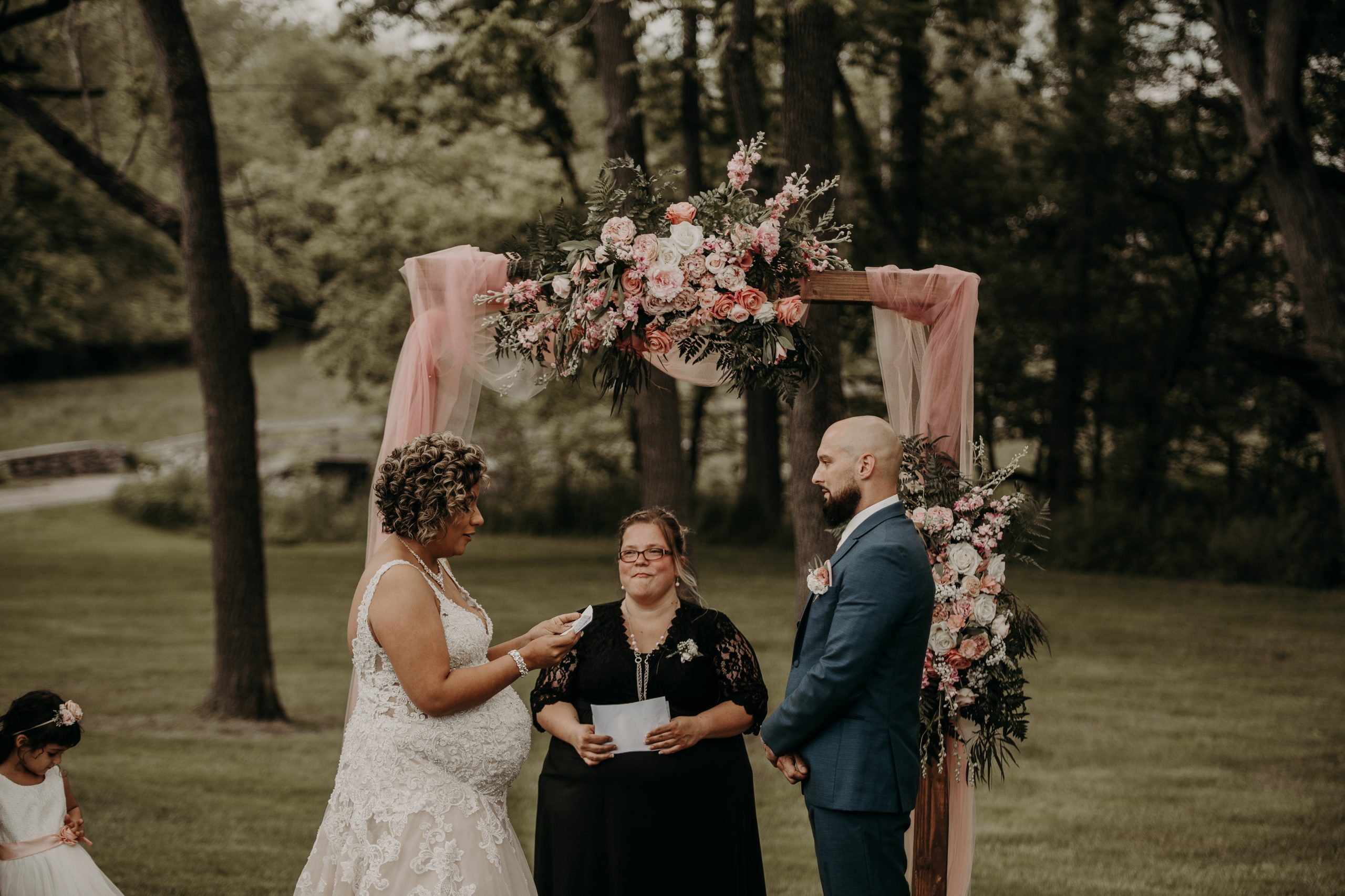 christine starts off with the vow reading and Richard is in awe of her. Christine and Richard wed on the Chestnut Hill Villa grounds on May of 2019. This organic ethereal styled wedding was captured by Garnet Dahlia Photography and featured on Dream Weddings.