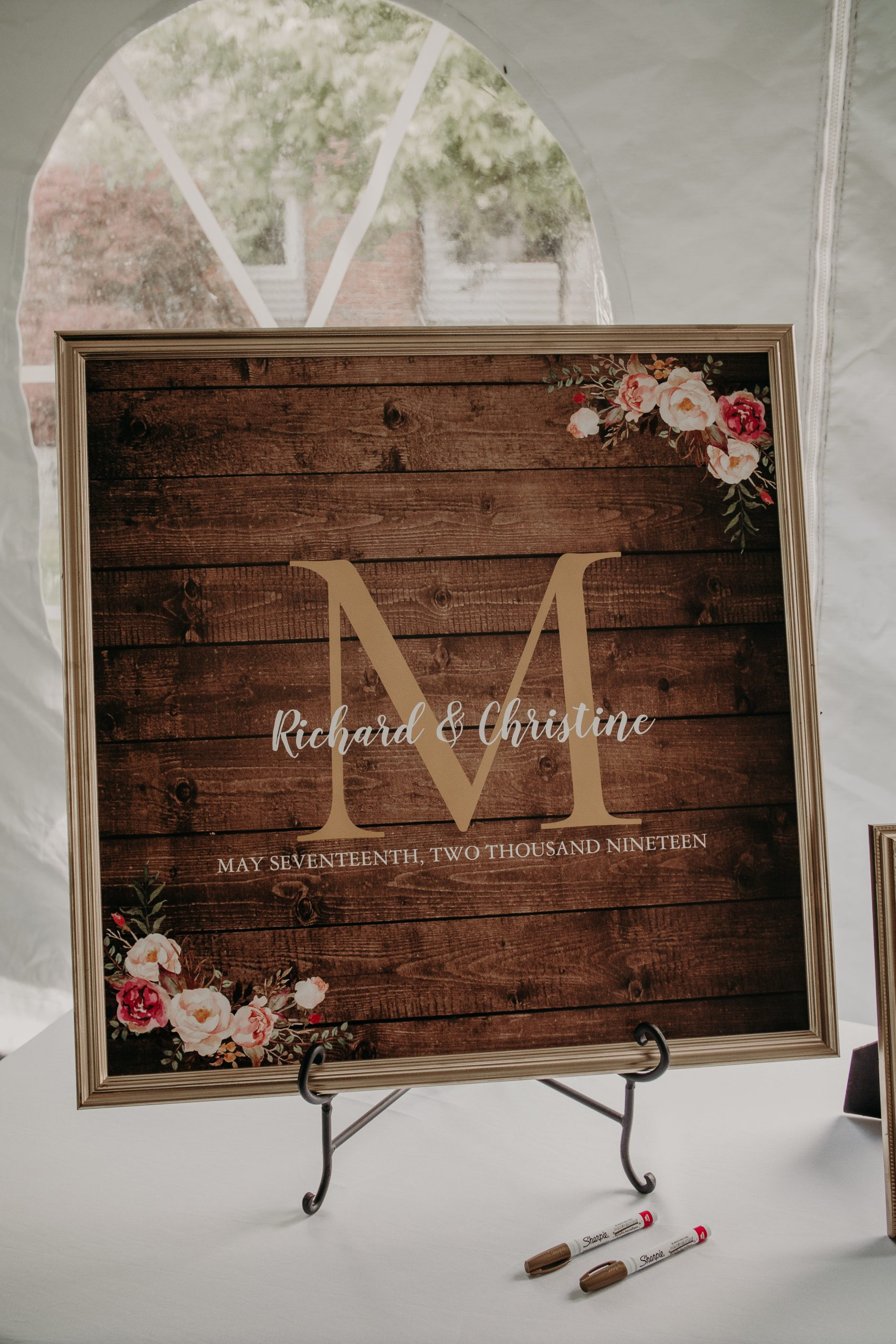 A monogramed piece of framed wood can help welcome your guests and later serve as home decor. Christine and Richard wed on the Chestnut Hill Villa grounds on May of 2019. This organic ethereal styled wedding was captured by Garnet Dahlia Photography and featured on Dream Weddings.