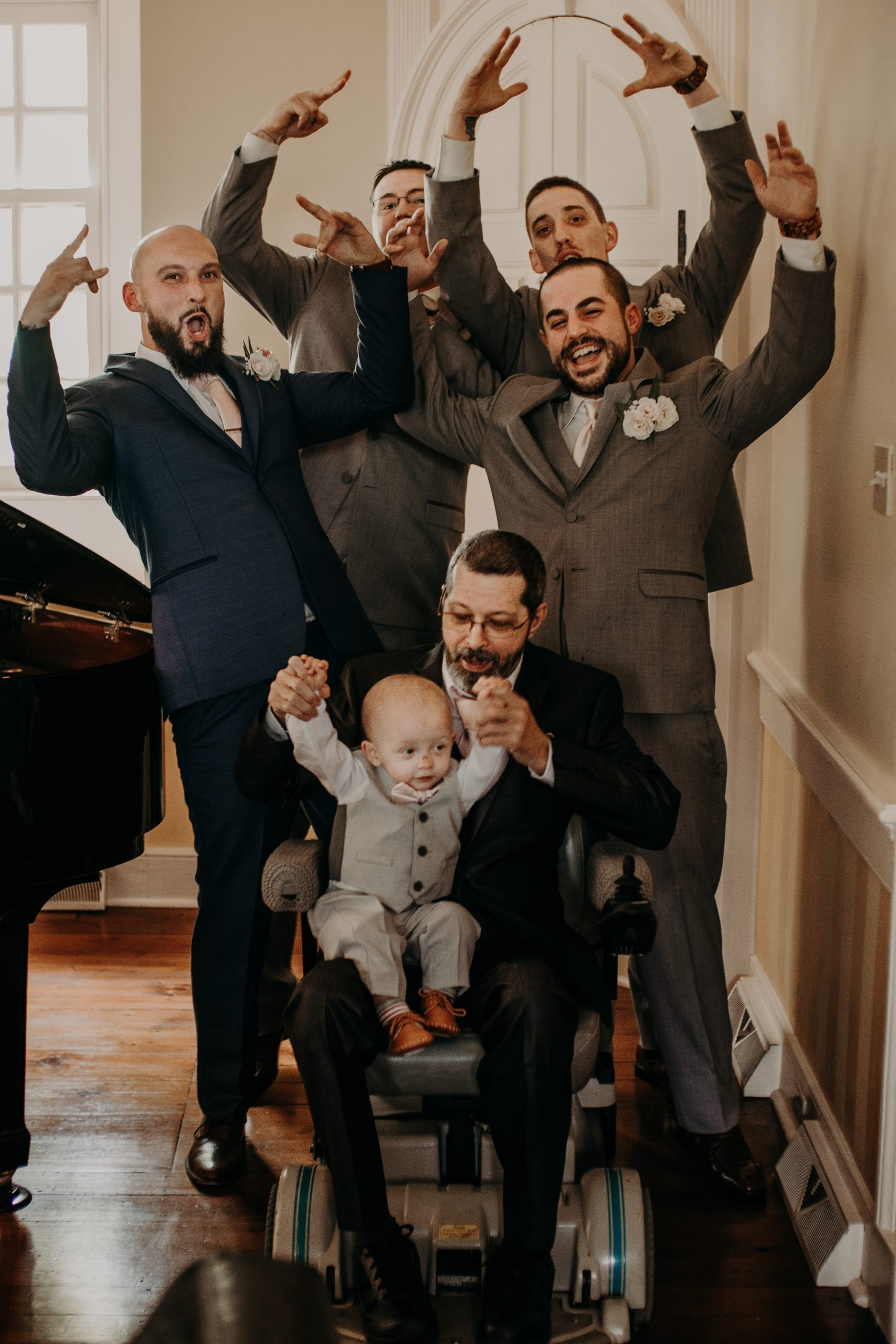 The groomsmen are ready to party. Setting himself apart, the groom wears a navy blue suite with pink tie, as the groomsmen sport grey suites with silver ties. Christine and Richard wed on the Chestnut Hill Villa grounds on May of 2019. This organic ethereal styled wedding was captured by Garnet Dahlia Photography and featured on Dream Weddings.