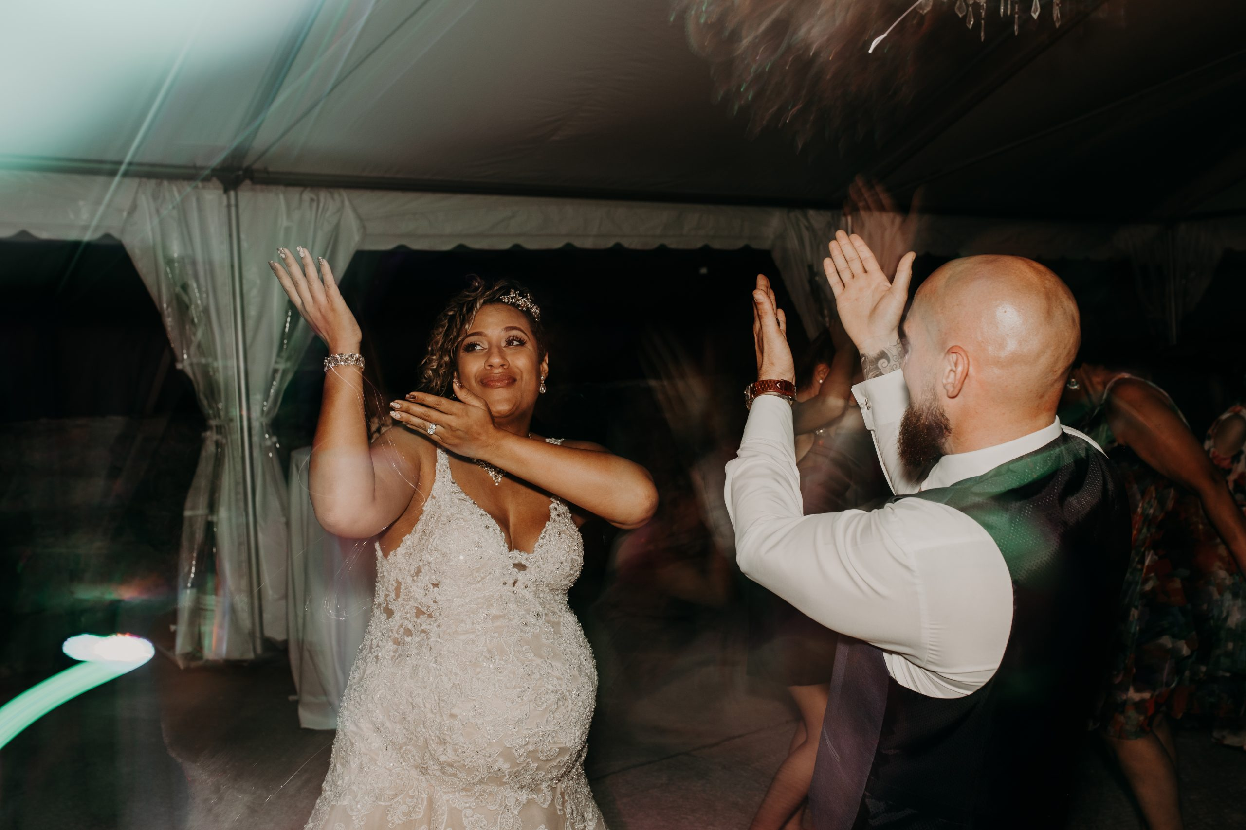 The newlyweds break it down on the dance floor. Christine and Richard wed on the Chestnut Hill Villa grounds on May of 2019. This organic ethereal styled wedding was captured by Garnet Dahlia Photography and featured on Dream Weddings.