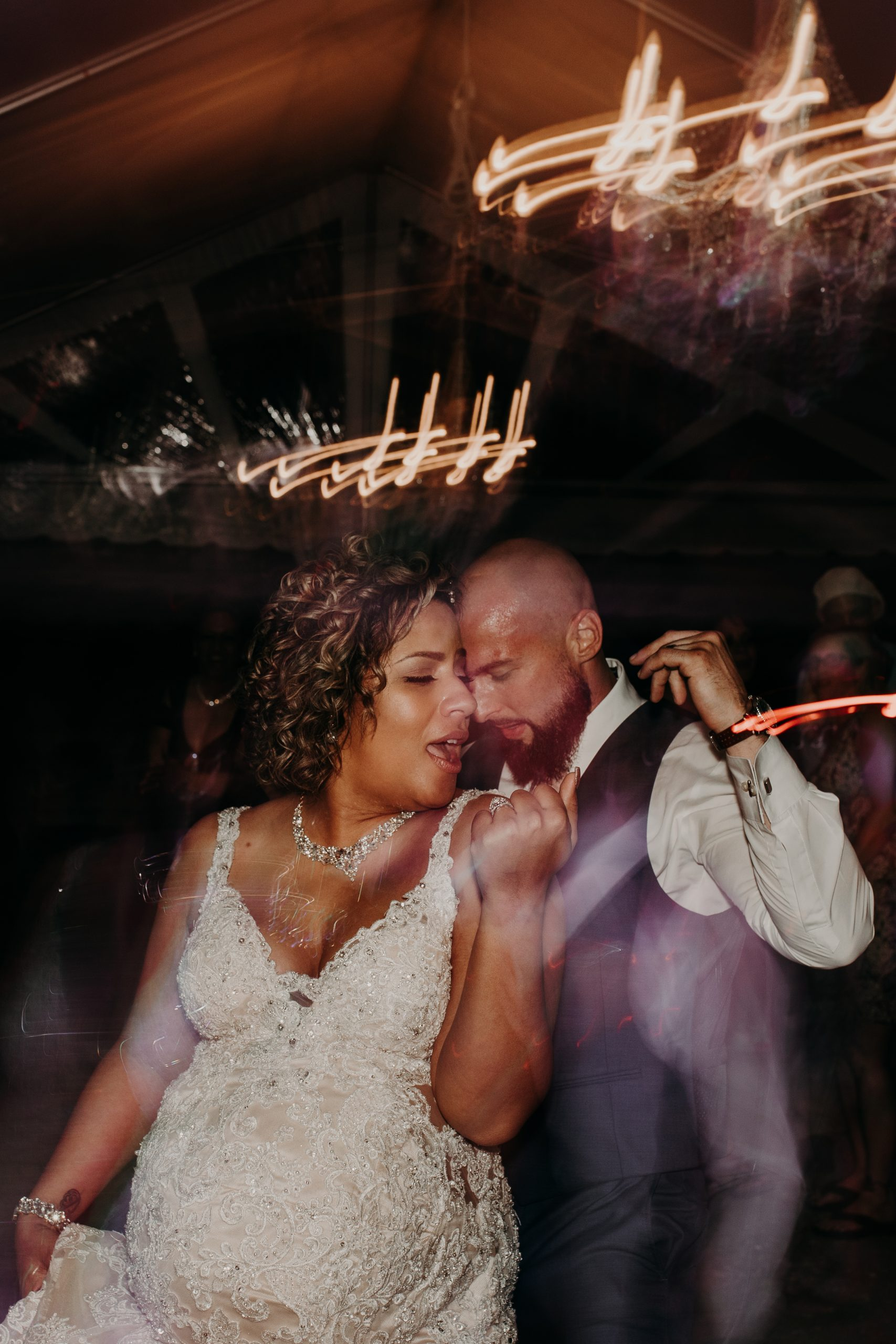 getting down and dirty on the dance floor the newly weds throw down. Christine and Richard wed on the Chestnut Hill Villa grounds on May of 2019. This organic ethereal styled wedding was captured by Garnet Dahlia Photography and featured on Dream Weddings.