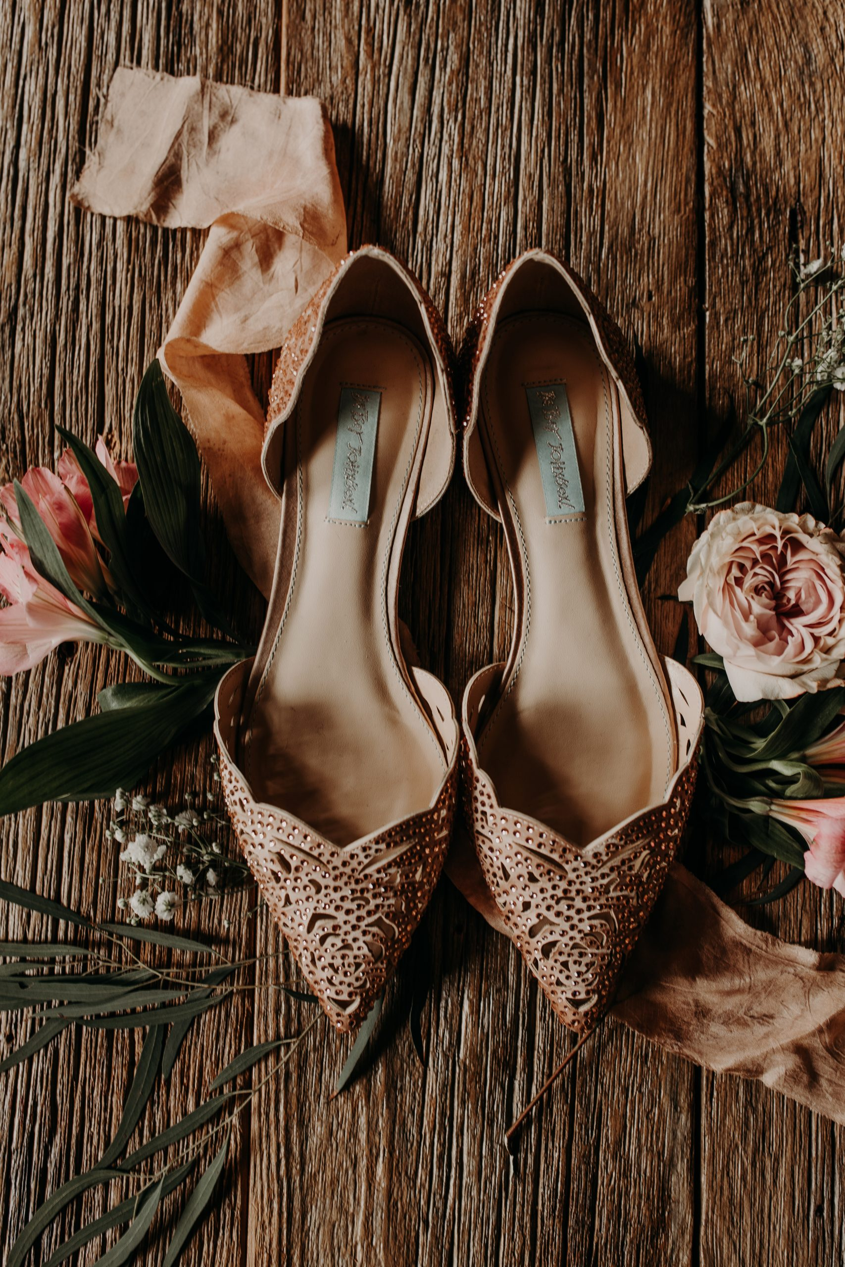 Pink, rhinestone studded heals are the perfect accent to set off any white dress. Christine and Richard wed on the Chestnut Hill Villa grounds on May of 2019. This organic ethereal styled wedding was captured by Garnet Dahlia Photography and featured on Dream Weddings.
