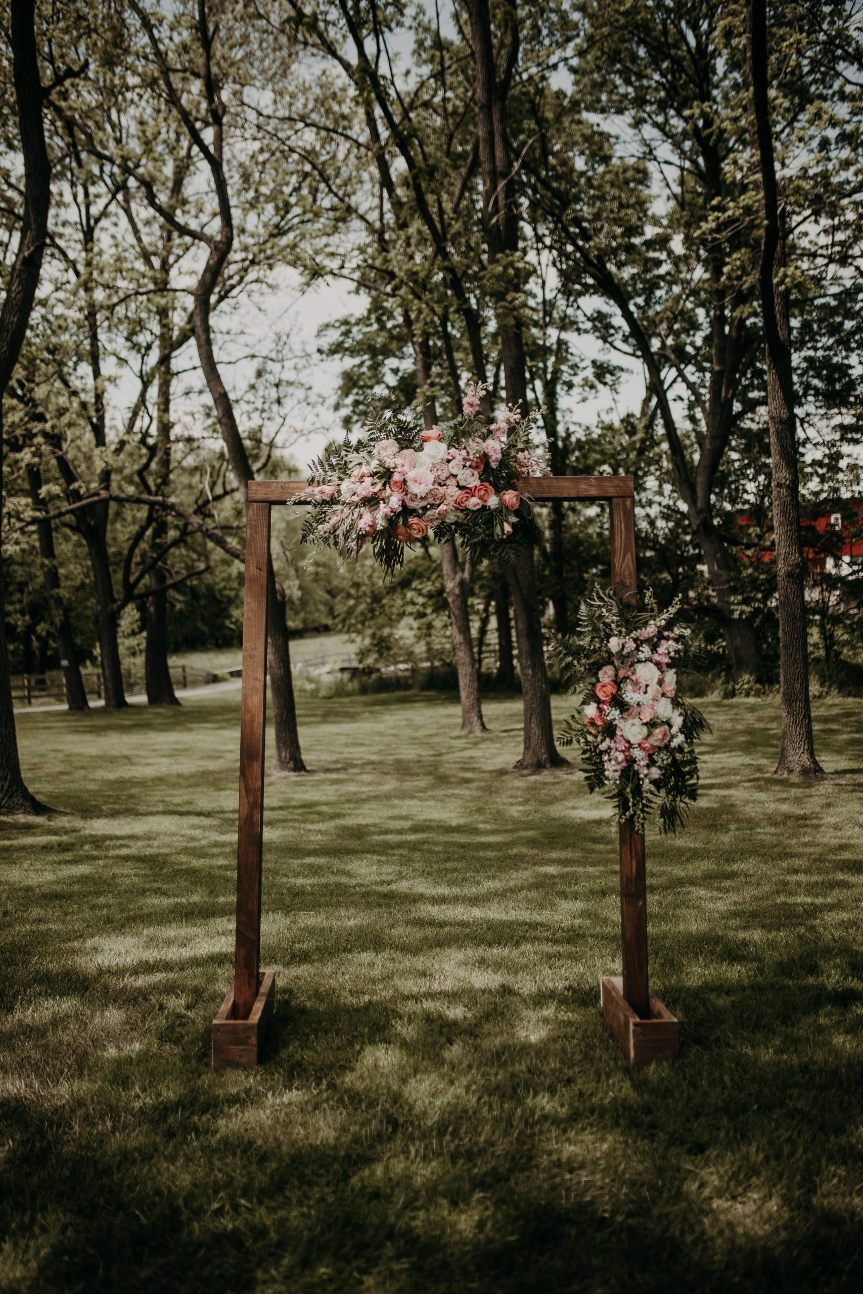 A picture perfect frame for the lovely couple with pinks, and rustic wood outline the love that is Richard and Christine. Christine and Richard wed on the Chestnut Hill Villa grounds on May of 2019. This organic ethereal styled wedding was captured by Garnet Dahlia Photography and featured on Dream Weddings.