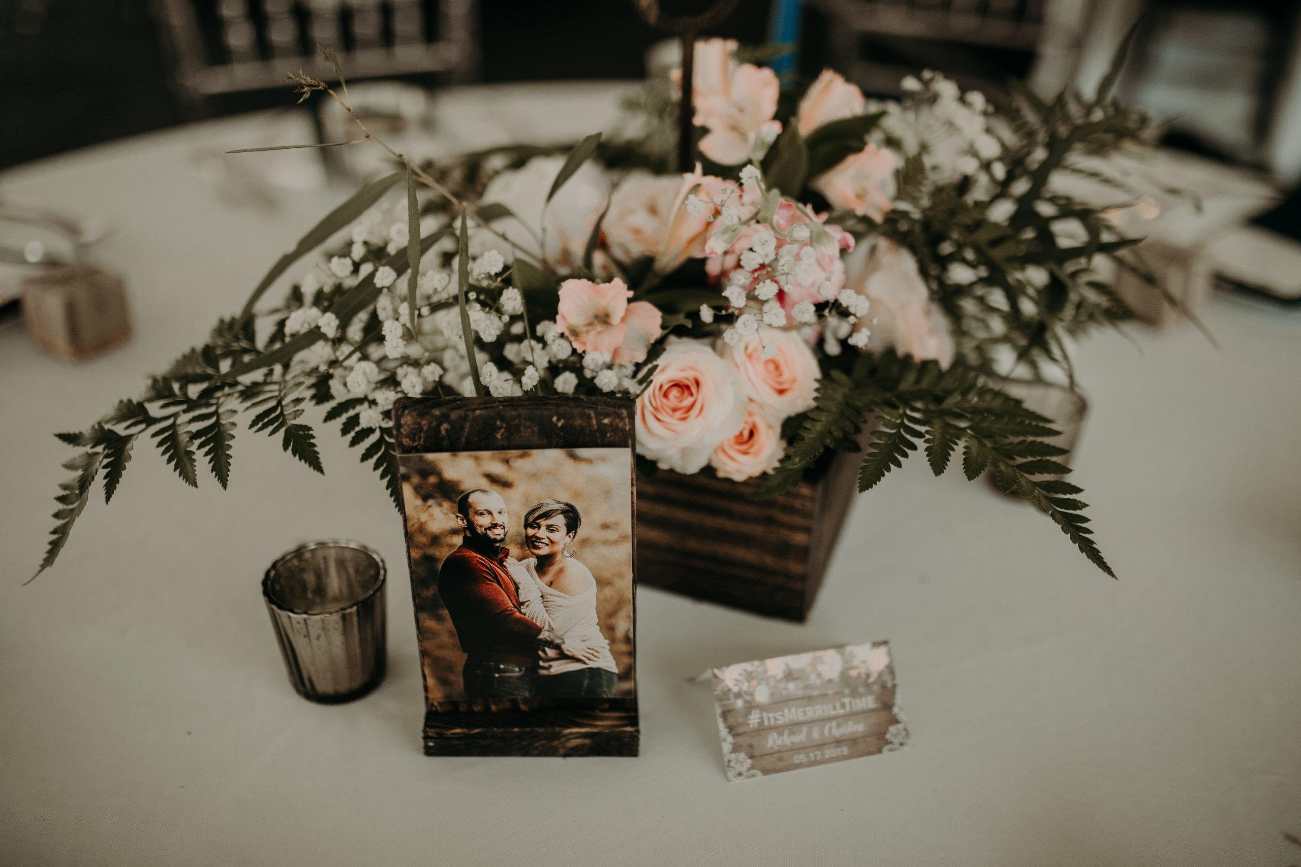 Pictures of the couple are placed on each table to reiterate the love they have for each other. Christine and Richard wed on the Chestnut Hill Villa grounds on May of 2019. This organic ethereal styled wedding was captured by Garnet Dahlia Photography and featured on Dream Weddings.