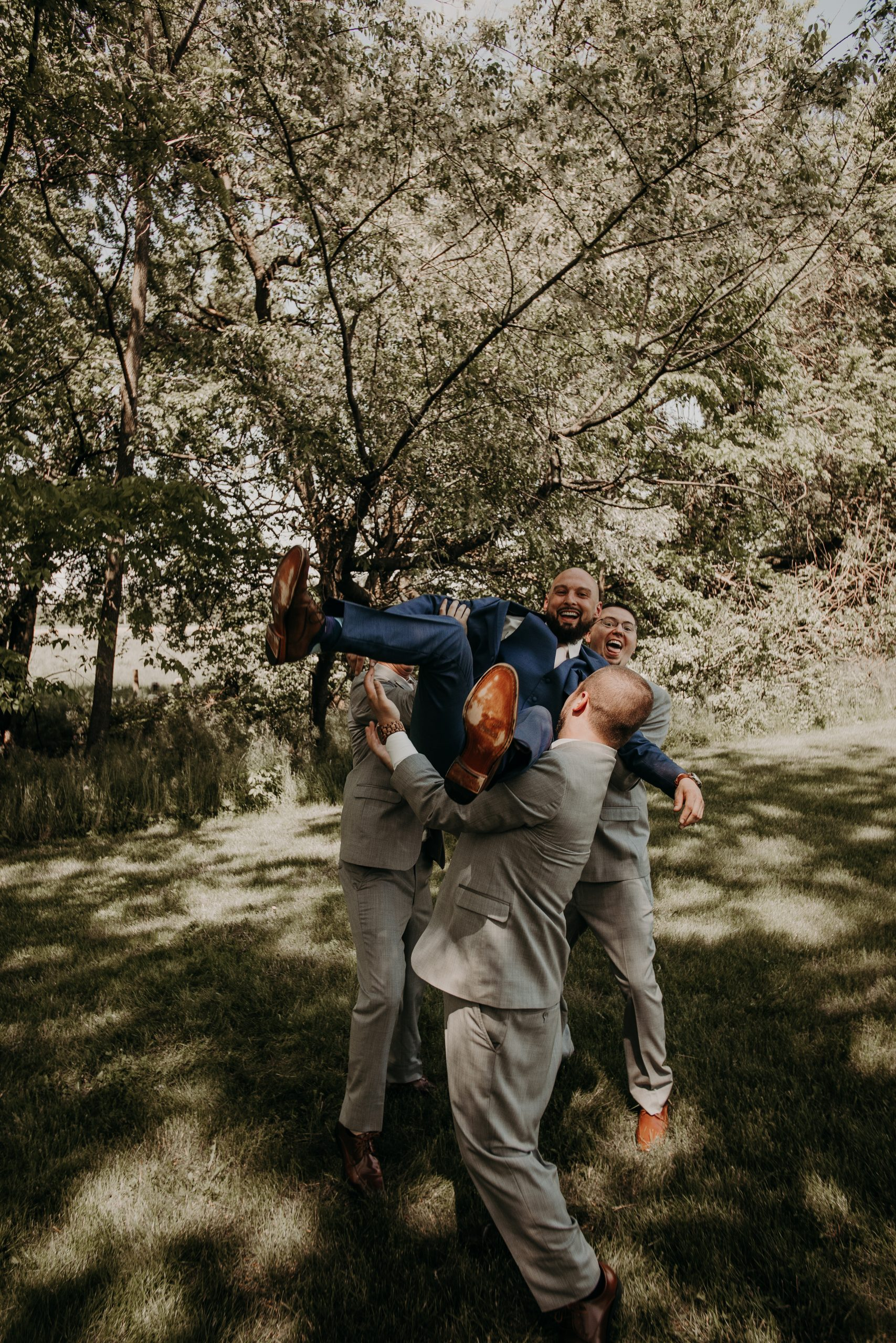 the groomsmen pull some shenanigans on their buddy who just got hitched. Christine and Richard wed on the Chestnut Hill Villa grounds on May of 2019. This organic ethereal styled wedding was captured by Garnet Dahlia Photography and featured on Dream Weddings.