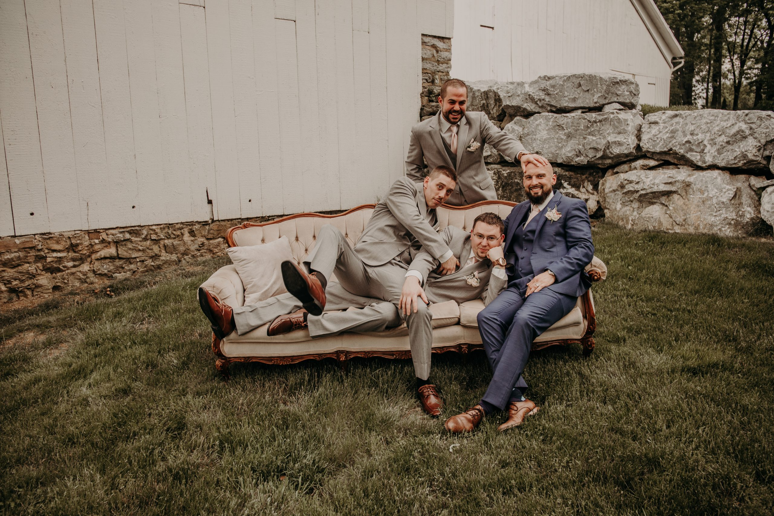Utilizing antique furniture in photos adds a vintage feel. A timelessness. Christine and Richard wed on the Chestnut Hill Villa grounds on May of 2019. This organic ethereal styled wedding was captured by Garnet Dahlia Photography and featured on Dream Weddings.
