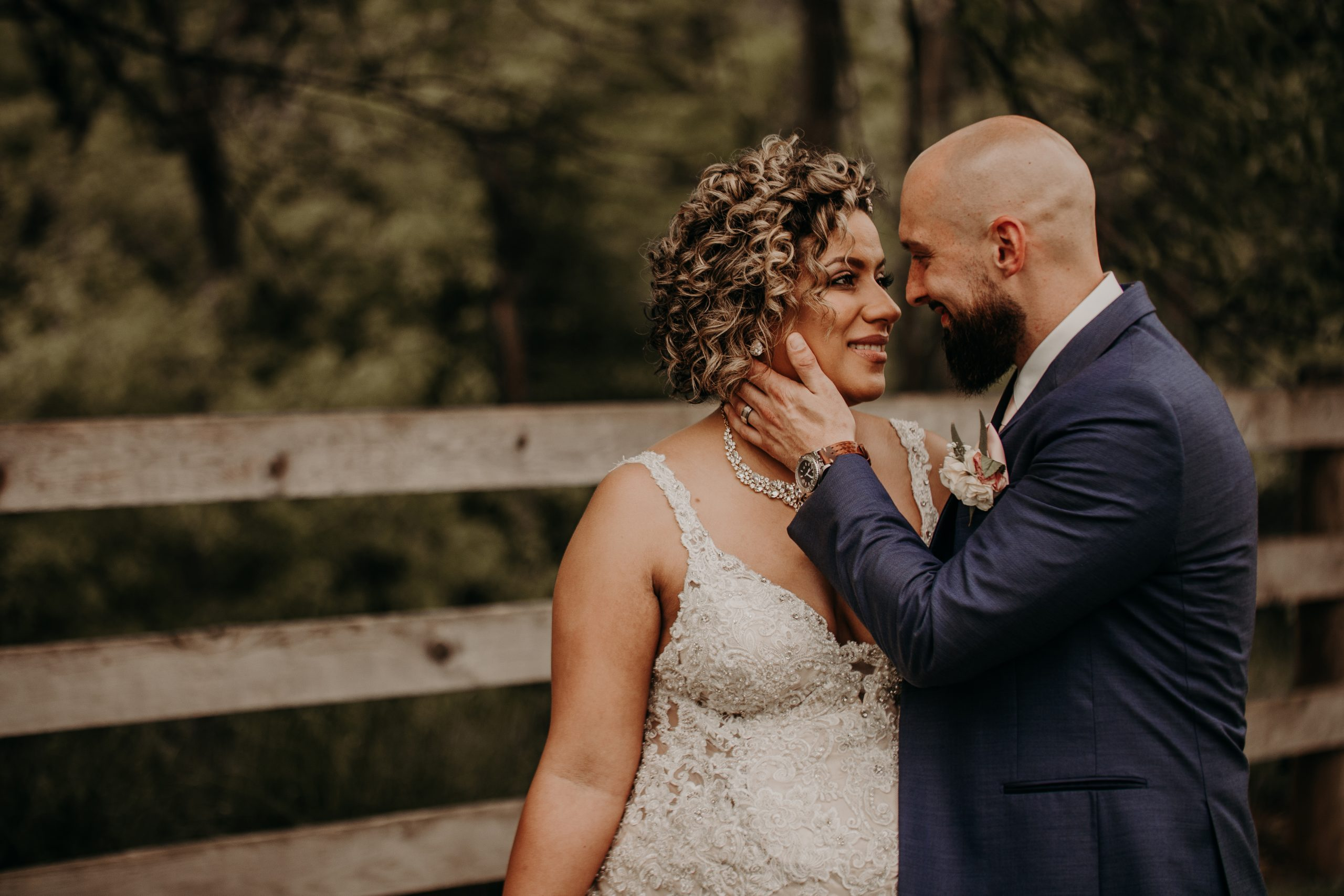 the newlyweds share a passionate look. Christine and Richard wed on the Chestnut Hill Villa grounds on May of 2019. This organic ethereal styled wedding was captured by Garnet Dahlia Photography and featured on Dream Weddings.