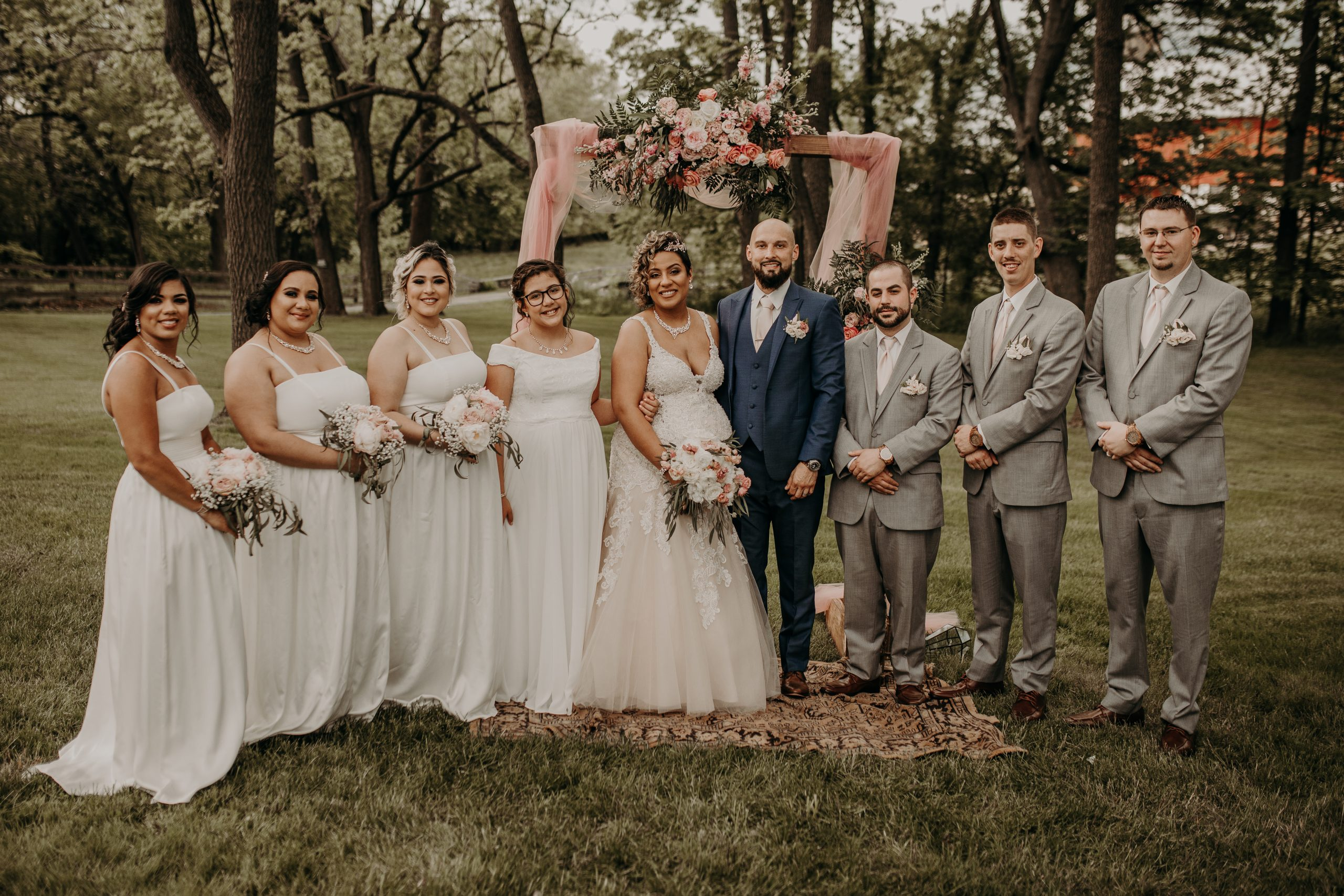 The whole wedding party is full of smiles knowing these two have finally wed. Christine and Richard wed on the Chestnut Hill Villa grounds on May of 2019. This organic ethereal styled wedding was captured by Garnet Dahlia Photography and featured on Dream Weddings.