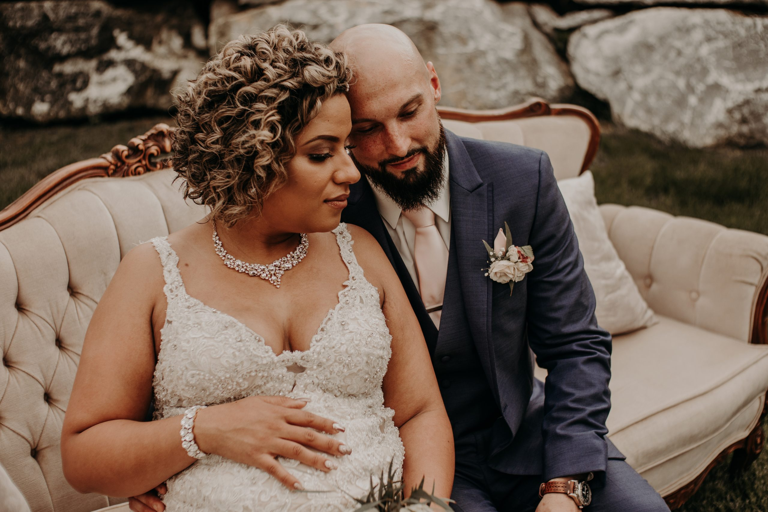 Embracing each other, the newly weds reflect on their special day. Christine and Richard wed on the Chestnut Hill Villa grounds on May of 2019. This organic ethereal styled wedding was captured by Garnet Dahlia Photography and featured on Dream Weddings.