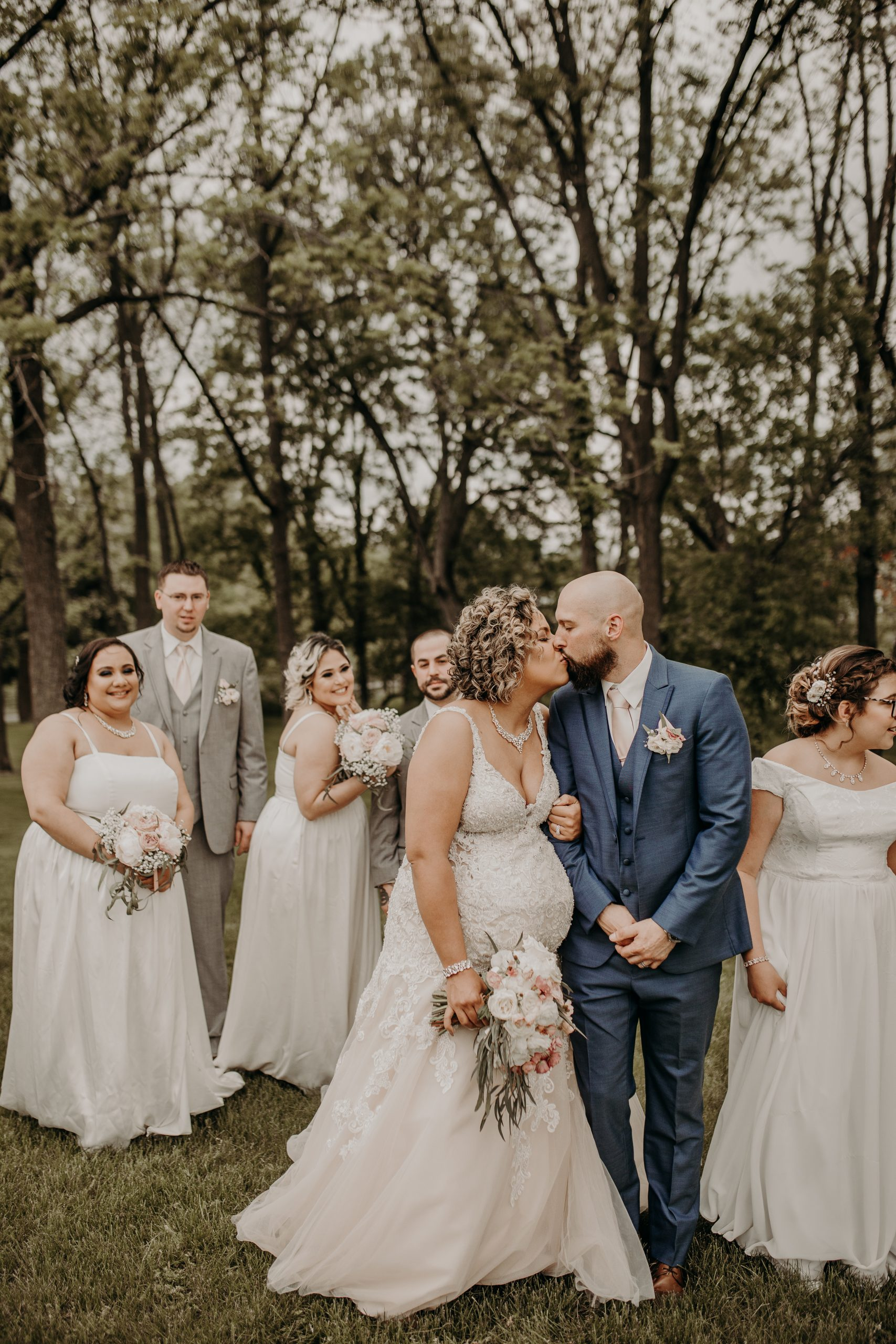 Everyone is giddy and full of joy for the newly weds. Greens in the background add depth and tie into the theme. Christine and Richard wed on the Chestnut Hill Villa grounds on May of 2019. This organic ethereal styled wedding was captured by Garnet Dahlia Photography and featured on Dream Weddings.
