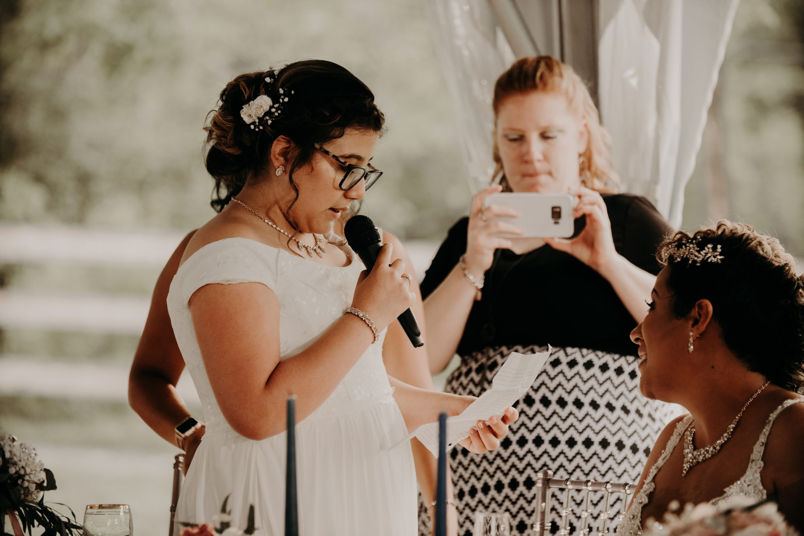 Daughter of the bride gives a speech at the reception. Christine and Richard wed on the Chestnut Hill Villa grounds on May of 2019. This organic ethereal styled wedding was captured by Garnet Dahlia Photography and featured on Dream Weddings.