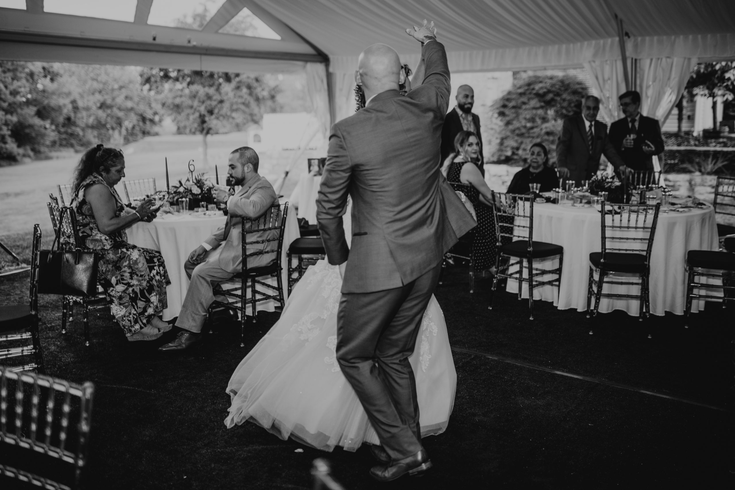 The bride and groom get giggy with it on the dance floor at their reception. Christine and Richard wed on the Chestnut Hill Villa grounds on May of 2019. This organic ethereal styled wedding was captured by Garnet Dahlia Photography and featured on Dream Weddings.