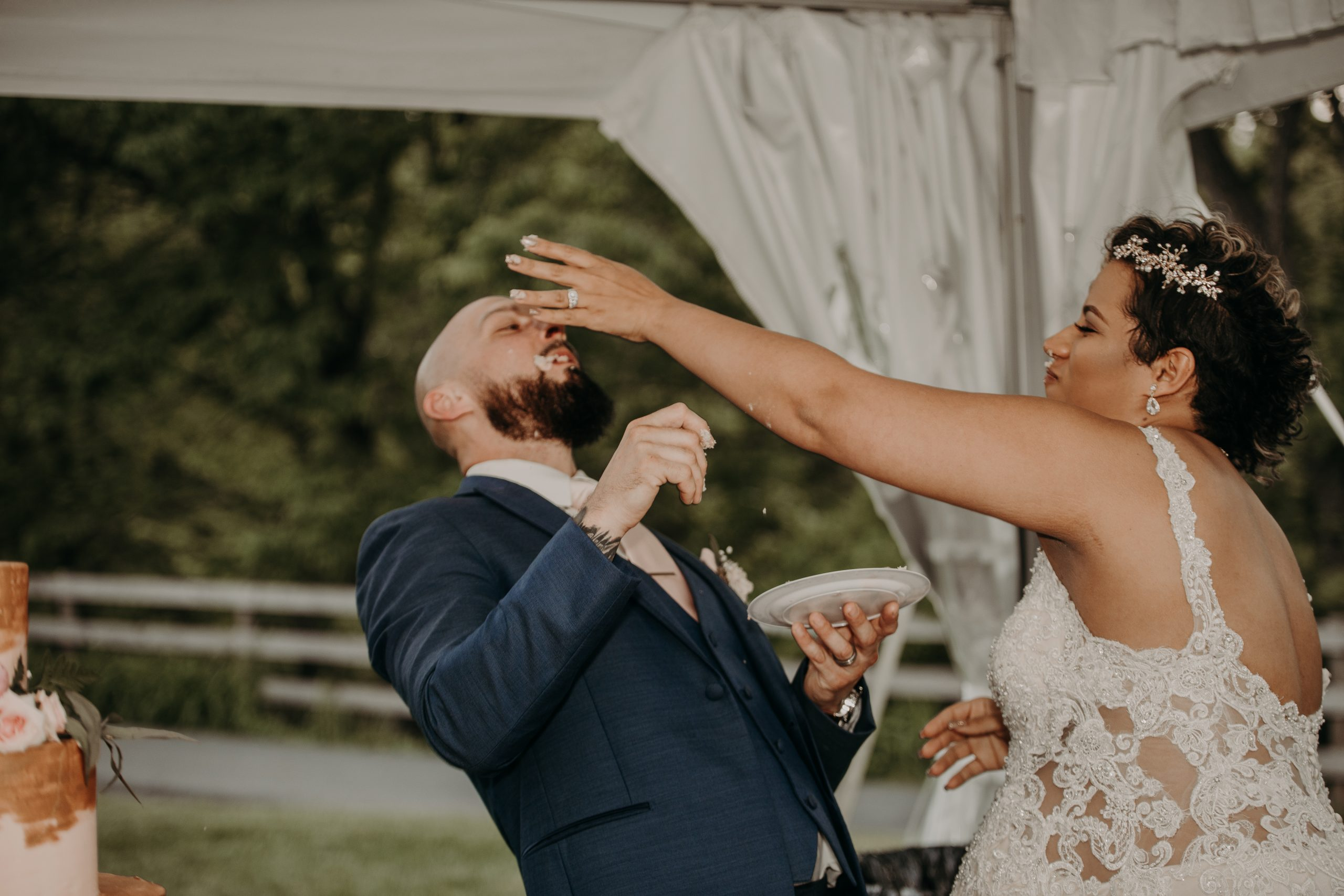 The bride got one up on the groom with some cake to the face after cutting the first slice. Christine and Richard wed on the Chestnut Hill Villa grounds on May of 2019. This organic ethereal styled wedding was captured by Garnet Dahlia Photography and featured on Dream Weddings.