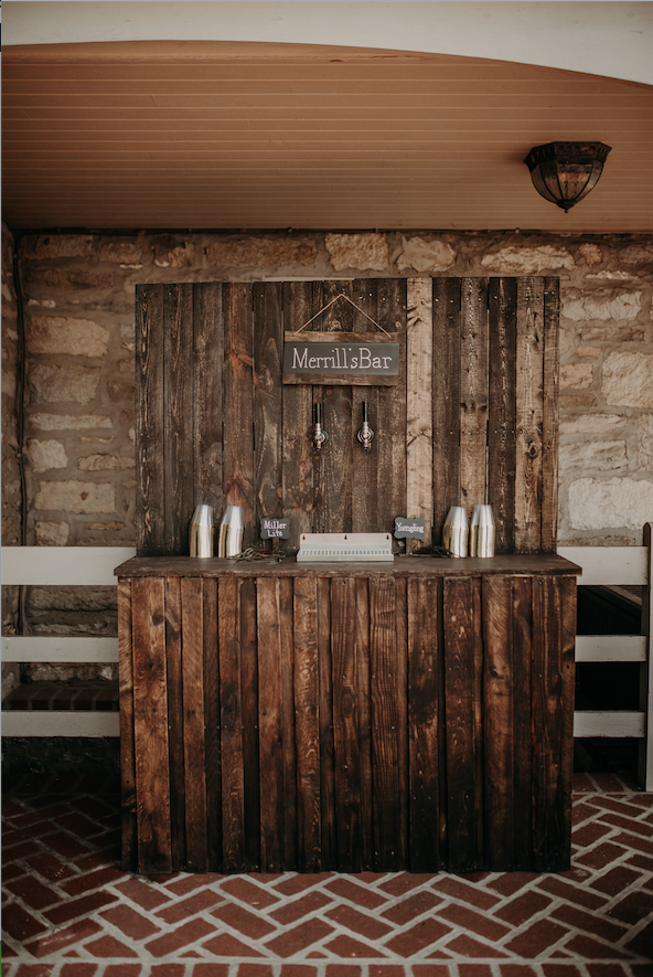 A rustic wooden bar setup carried over the theme and added some character to the special day. Christine and Richard wed on the Chestnut Hill Villa grounds on May of 2019. This organic ethereal styled wedding was captured by Garnet Dahlia Photography and featured on Dream Weddings.