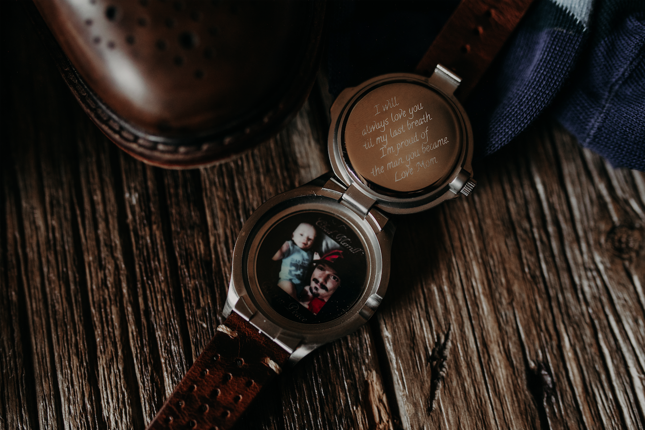 Richard's other gifted him a watch with a picture of him and his son. Etched in the back of the clock face is a heart felt note to the soon to be married man. Christine and Richard wed on the Chestnut Hill Villa grounds on May of 2019. This organic ethereal styled wedding was captured by Garnet Dahlia Photography and featured on Dream Weddings.