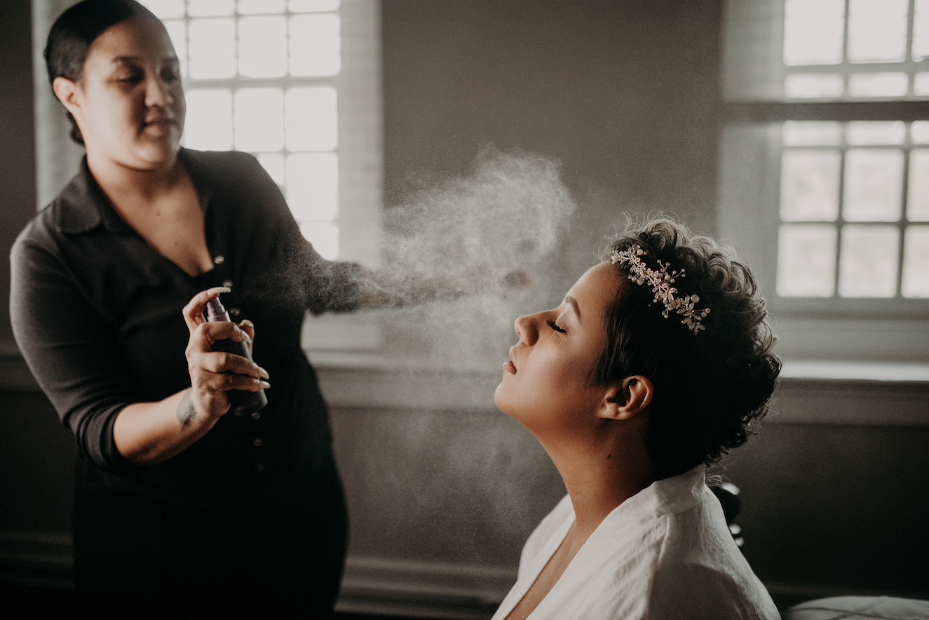 Setting the bride's curls with some hairspray completes the glam look. Now onto getting into the dress. Christine and Richard wed on the Chestnut Hill Villa grounds on May of 2019. This organic ethereal styled wedding was captured by Garnet Dahlia Photography and featured on Dream Weddings.