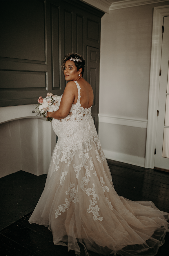 The bride is ready to walk down the isle in her custom fitted dress, baby bump and all. Christine and Richard wed on the Chestnut Hill Villa grounds on May of 2019. This organic ethereal styled wedding was captured by Garnet Dahlia Photography and featured on Dream Weddings.