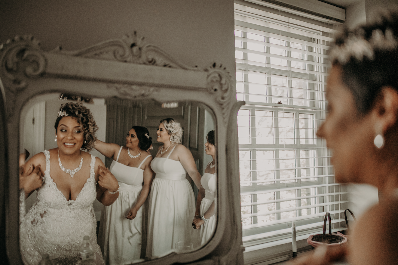 Last look in the mirror before she walks down the isle. Lovely jewels dripping from her neck and dangling earrings create an element of class. Christine and Richard wed on the Chestnut Hill Villa grounds on May of 2019. This organic ethereal styled wedding was captured by Garnet Dahlia Photography and featured on Dream Weddings.