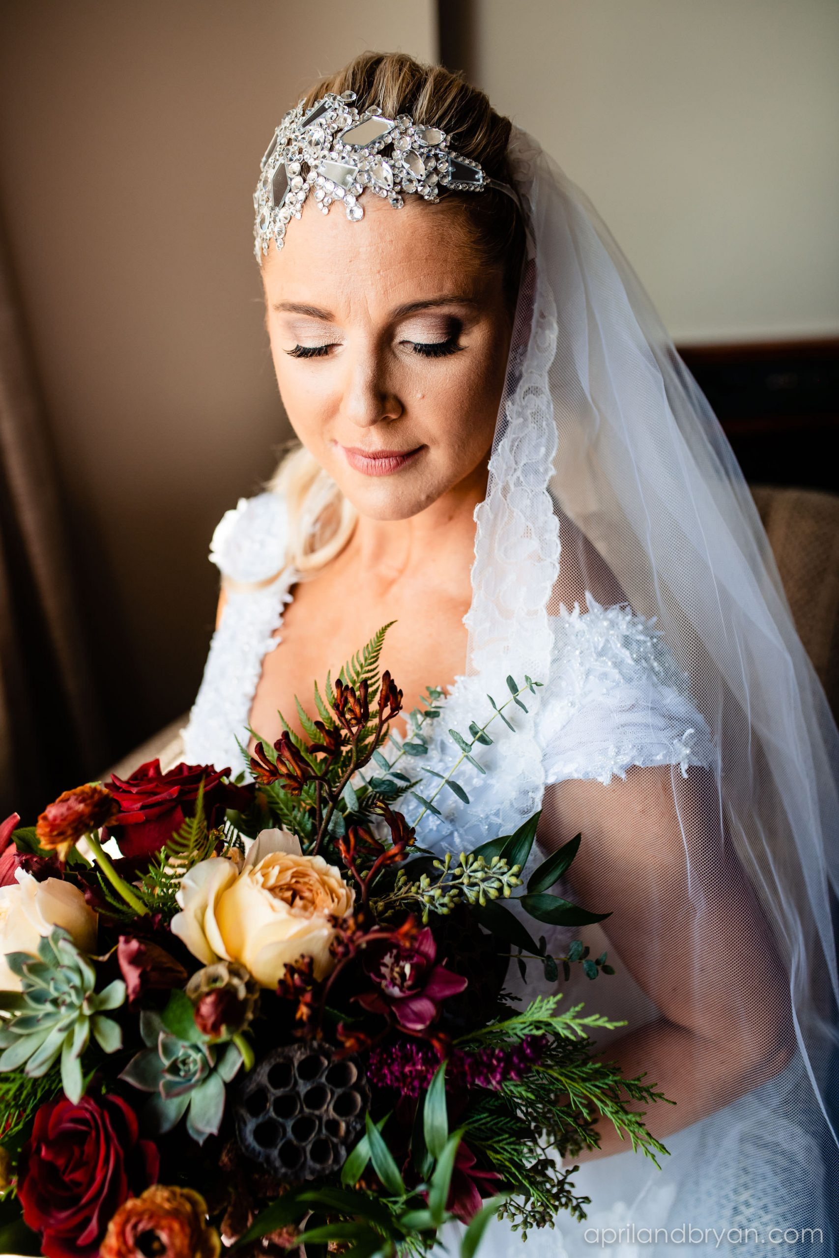 The bride is ready to walk down the isle. makeup done and a bedazzling head piece to match, Rebecca is ready. Nicholas and Rebecca Fasnacht tie the not at Tellus360 on November 1, 2019. Captured by April & Bryan Photography and featured on Dream Weddings.