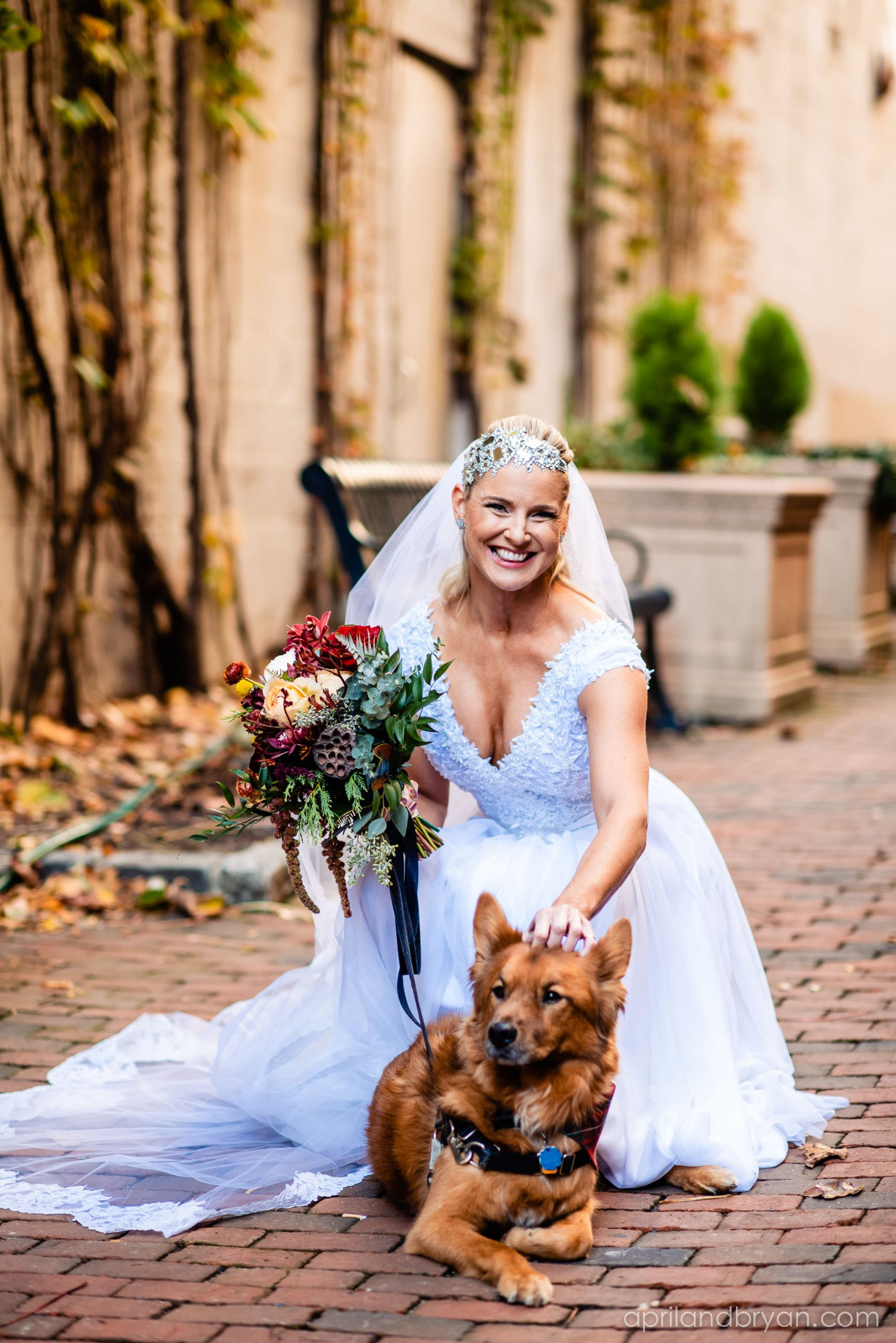 The bride gets a chance to take some photos with the family dog before the ceremony. Nicholas and Rebecca Fasnacht tie the not at Tellus360 on November 1, 2019. Captured by April & Bryan Photography and featured on Dream Weddings.