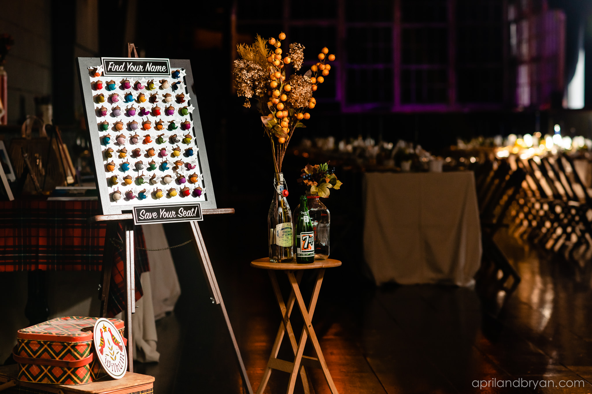 Guests could find their names and where they would be sitting on colorful acorns that were to be picked off and taklen to their assigned spot.Nicholas and Rebecca Fasnacht tie the not at Tellus360 on November 1, 2019. Captured by April & Bryan Photography and featured on Dream Weddings.