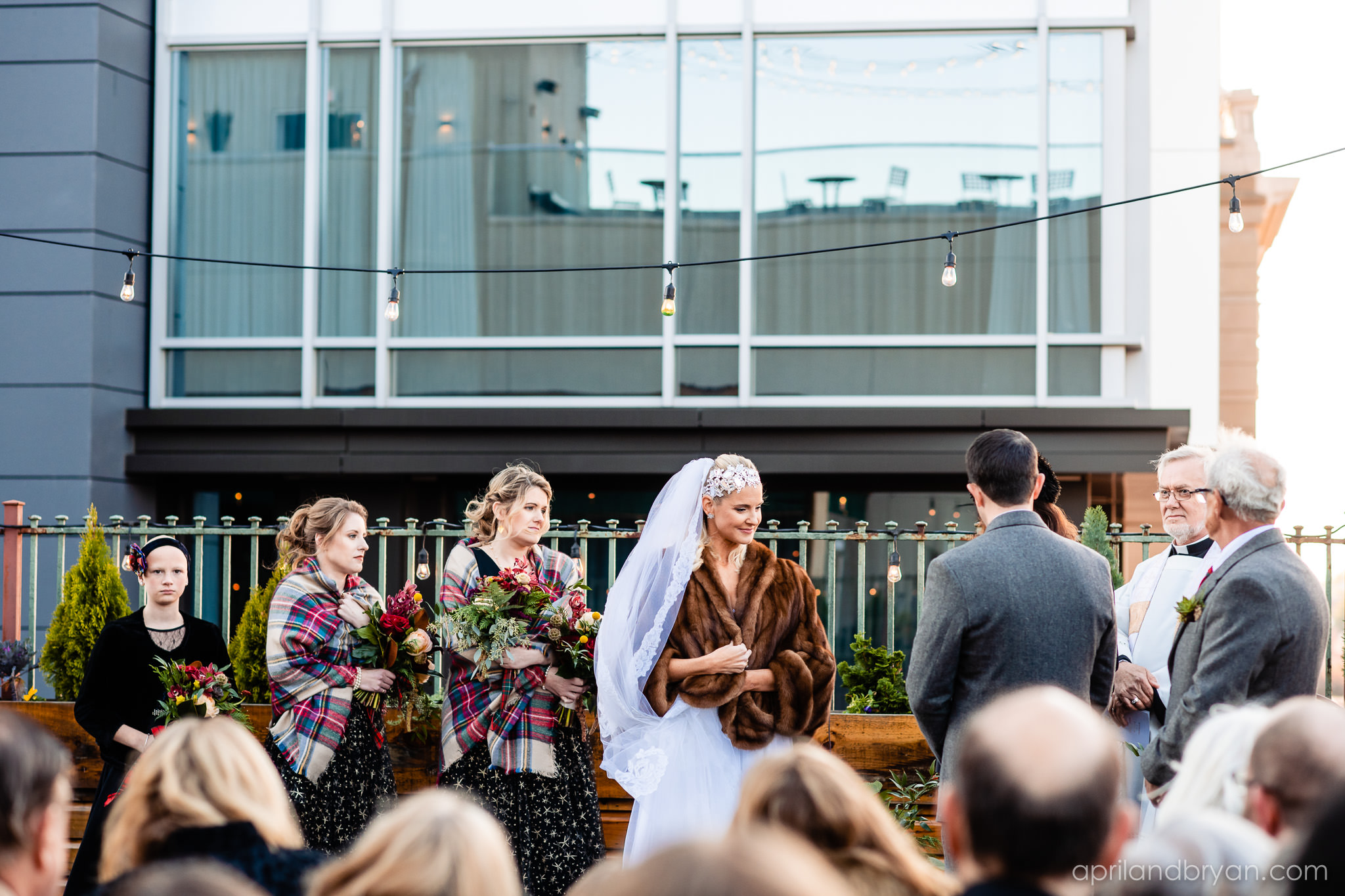 The two prepare to say I do on the rooftop with an Irish flare. Nicholas and Rebecca Fasnacht tie the not at Tellus360 on November 1, 2019. Captured by April & Bryan Photography and featured on Dream Weddings.