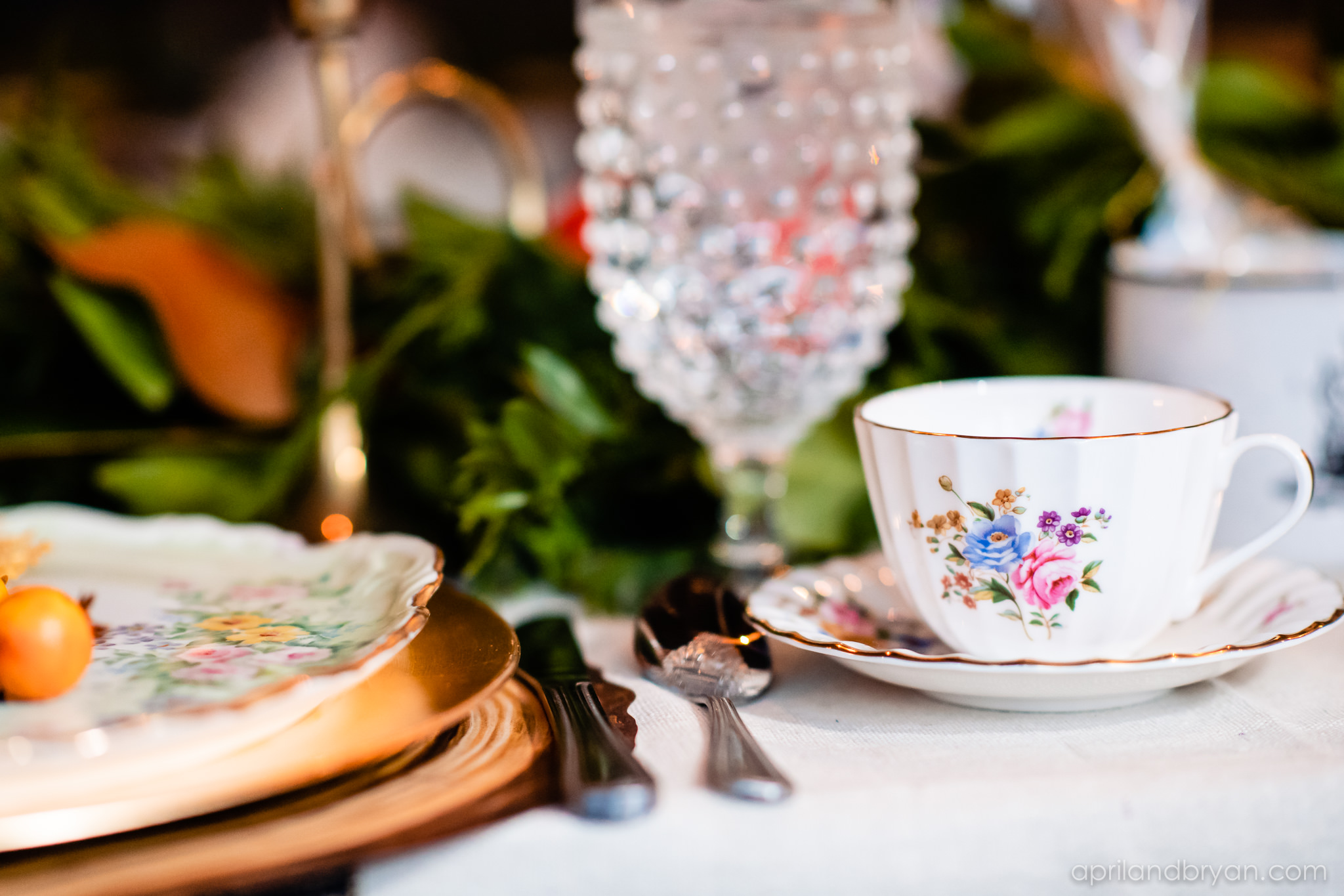 Flower painted tea cups, crystal goblets and gold were definitely a table theme. Nicholas and Rebecca Fasnacht tie the not at Tellus360 on November 1, 2019. Captured by April & Bryan Photography and featured on Dream Weddings.