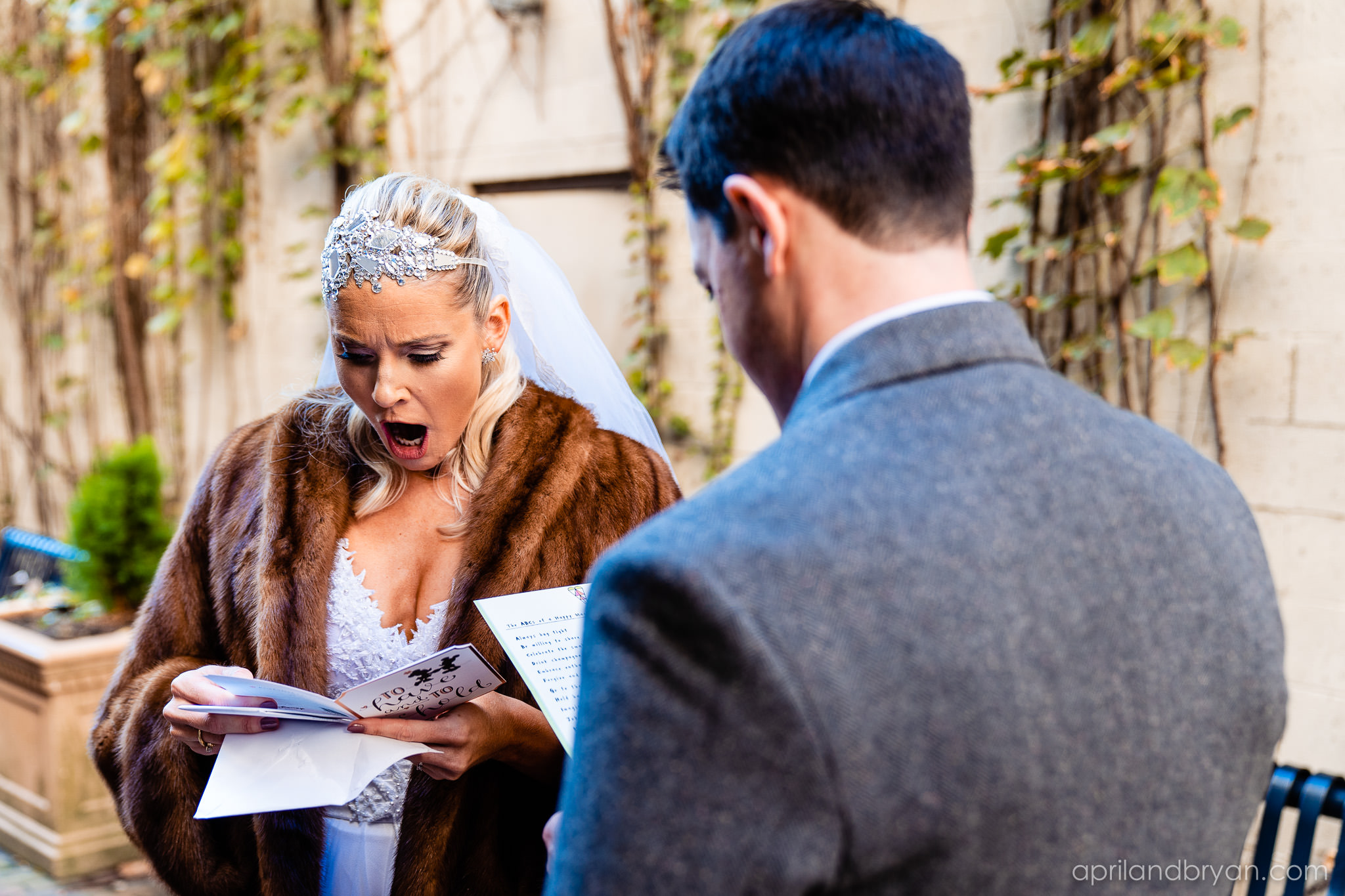 exchanging cards before their ceremony. Nicholas and Rebecca Fasnacht tie the not at Tellus360 on November 1, 2019. Captured by April & Bryan Photography and featured on Dream Weddings.