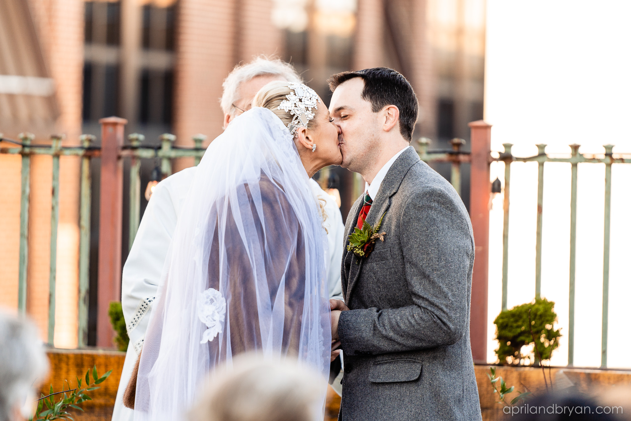 the couple said i DO AND SEAL IT WITH A KISS. Nicholas and Rebecca Fasnacht tie the not at Tellus360 on November 1, 2019. Captured by April & Bryan Photography and featured on Dream Weddings.
