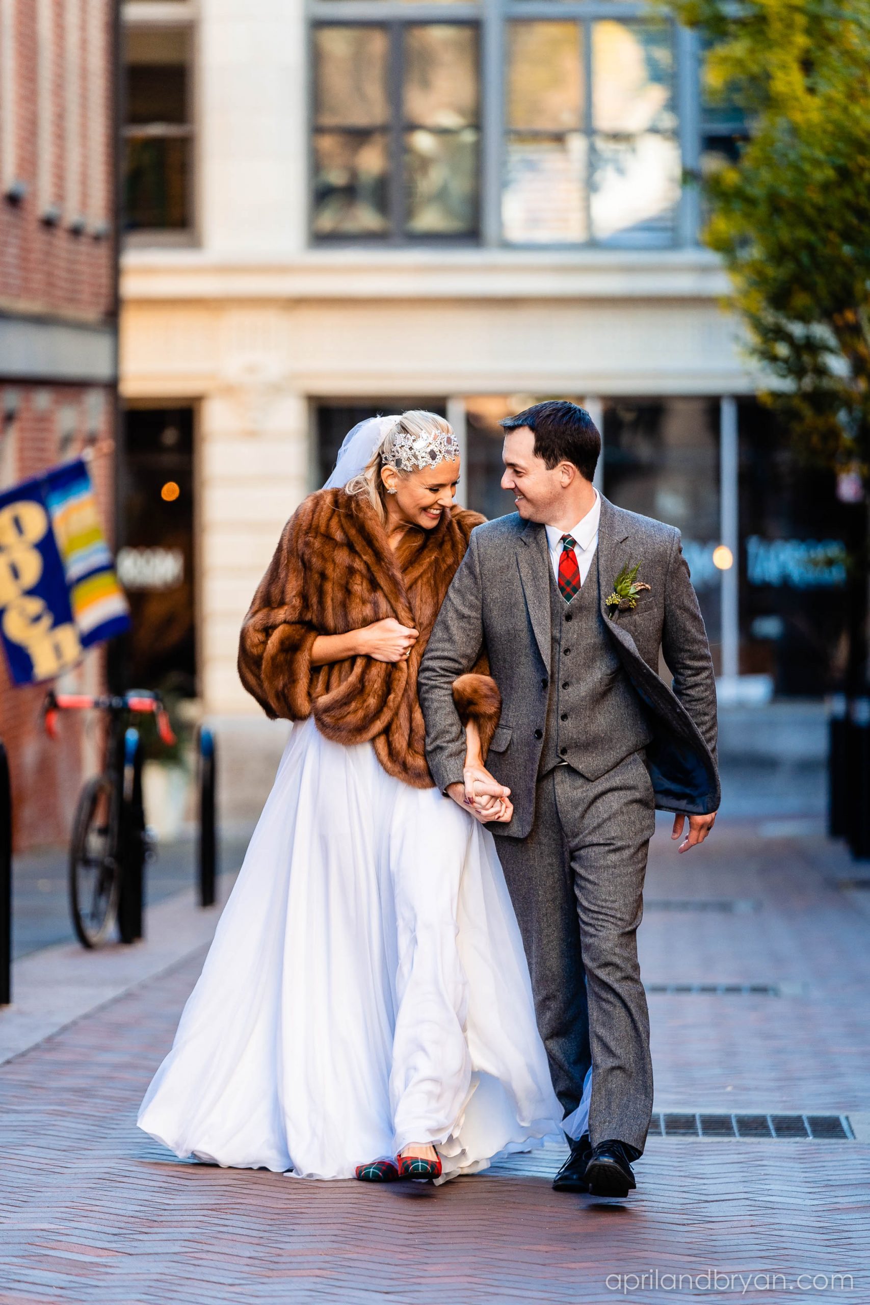 the newly wedded couple enjoy each other's company on the chilly noVEMBER DAY. Nicholas and Rebecca Fasnacht tie the not at Tellus360 on November 1, 2019. Captured by April & Bryan Photography and featured on Dream Weddings.