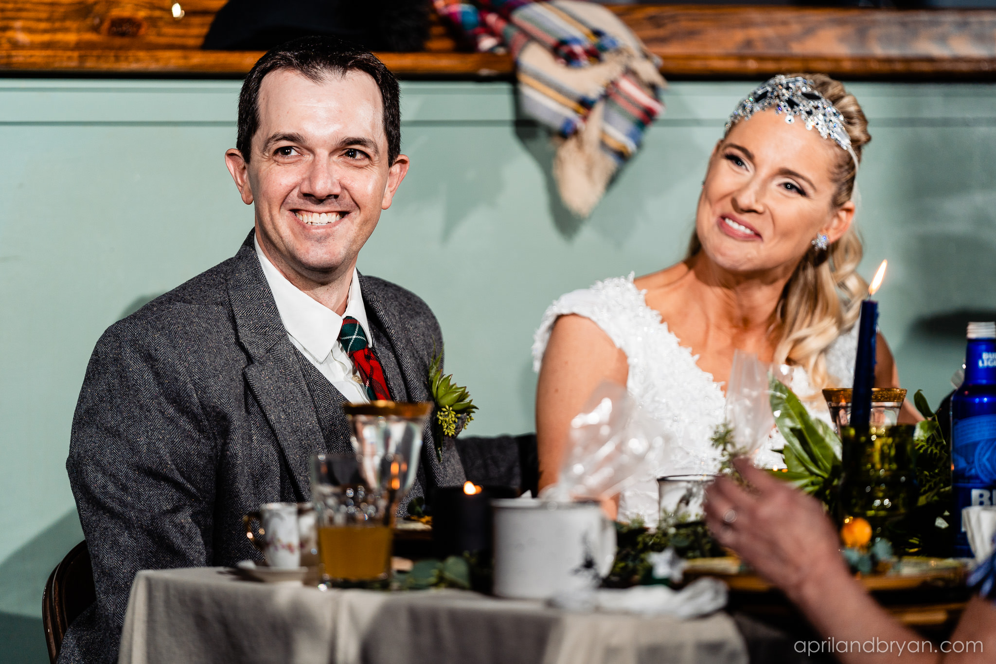 the newly weds react to speeches given at the reception. All smiles. Nicholas and Rebecca Fasnacht tie the not at Tellus360 on November 1, 2019. Captured by April & Bryan Photography and featured on Dream Weddings.