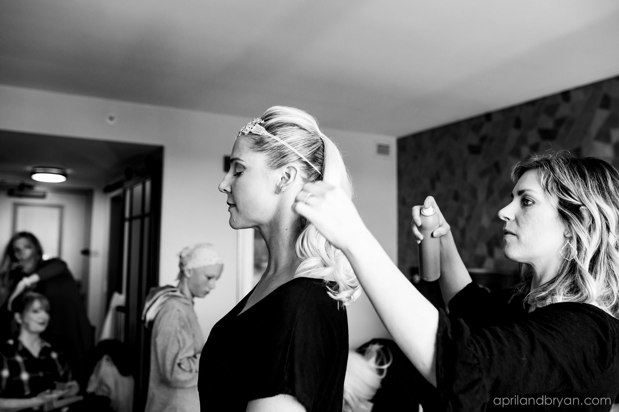 Hair and makeupp before the ceremony is a must. The bride has mounted her head piece. now just to put on the dress! Nicholas and Rebecca Fasnacht tie the not at Tellus360 on November 1, 2019. Captured by April & Bryan Photography and featured on Dream Weddings.