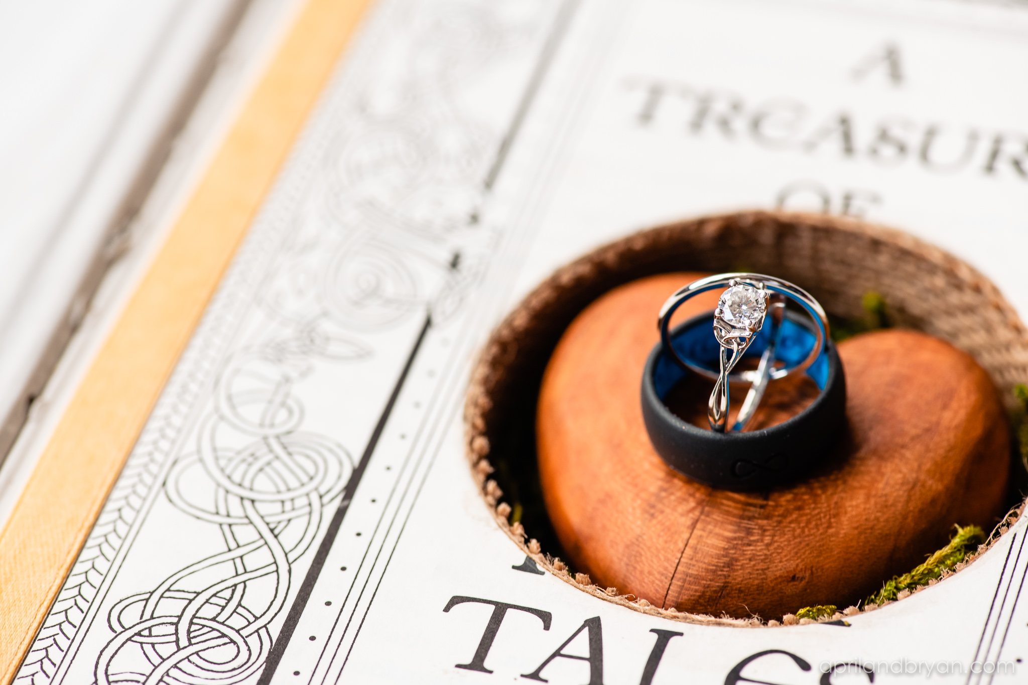 The rings boasted a Celtic design overlapping lines. Nicholas and Rebecca Fasnacht tie the not at Tellus360 on November 1, 2019. Captured by April & Bryan Photography and featured on Dream Weddings.