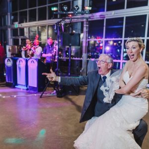 Bride and her father laughing at dancing at her wedding